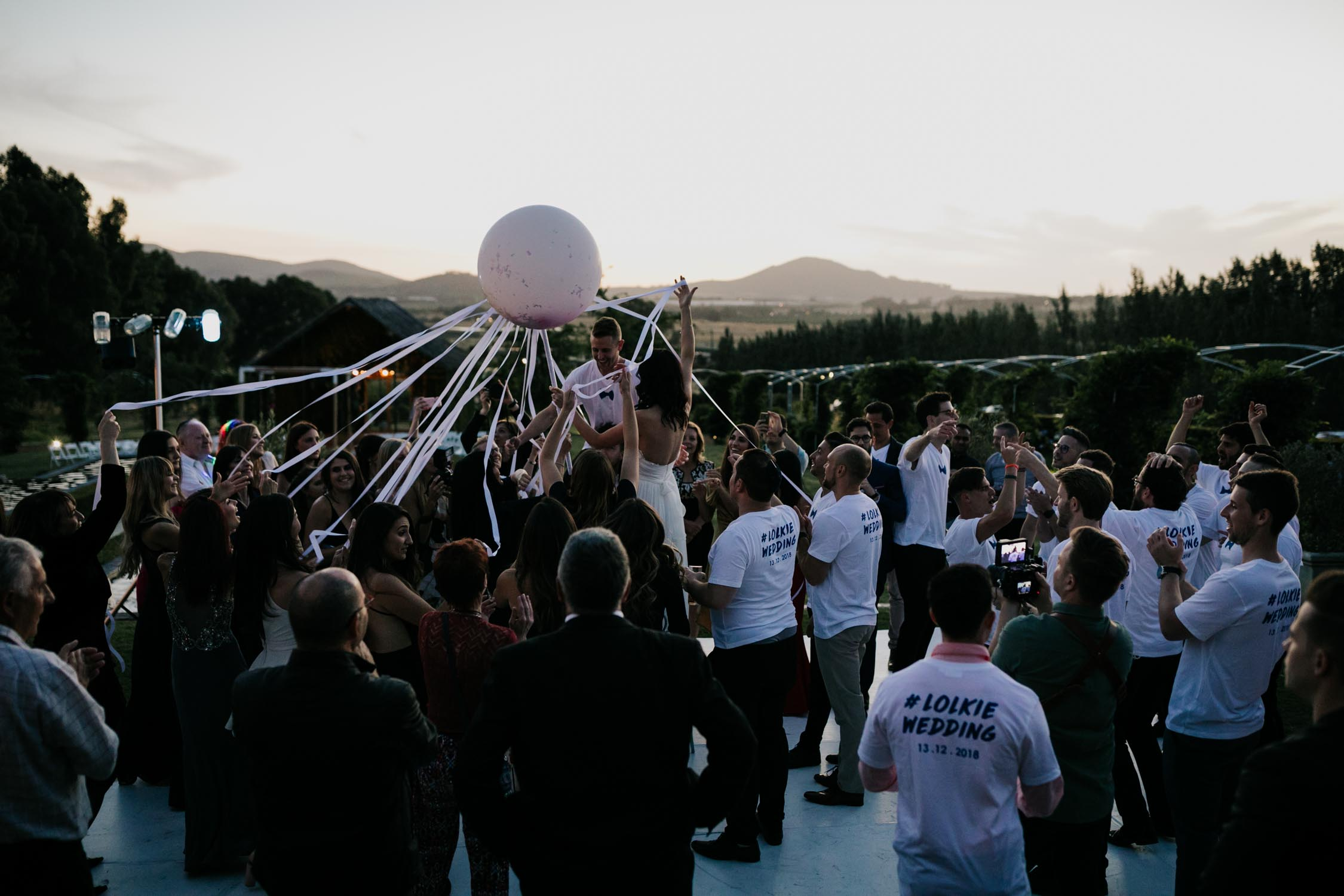 Epic balloon pop photo from Jewish horas Cape Town Wedding Photographer