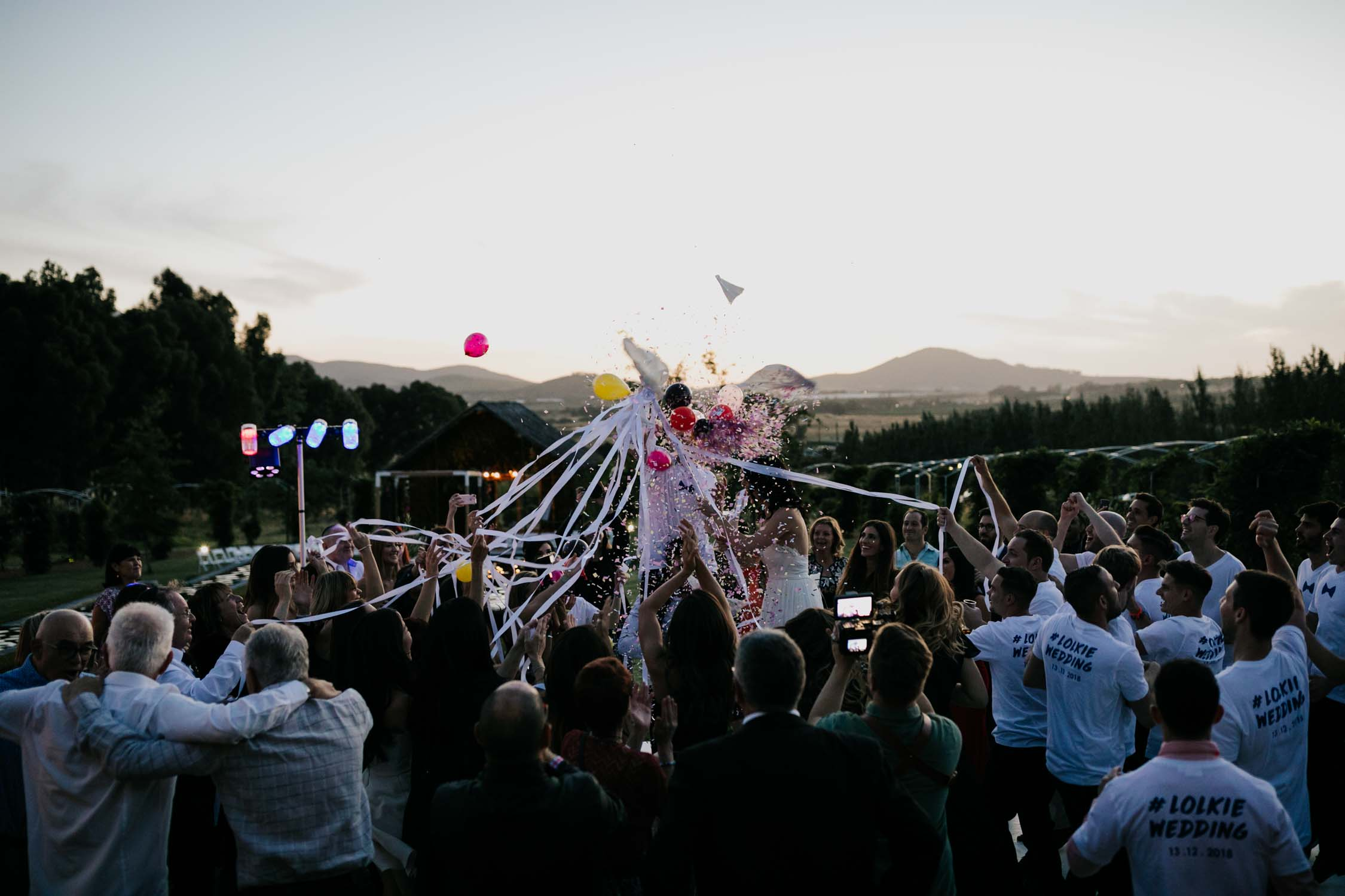 Epic balloon pop and confetti photo from Jewish horas Cape Town Wedding Photographer