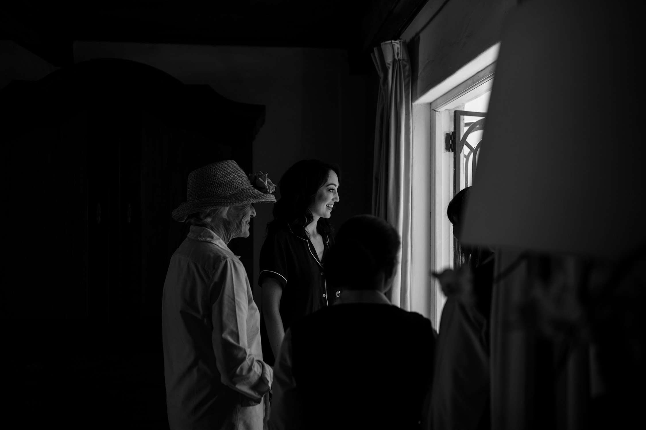 Black and white photojournalistic wedding photo