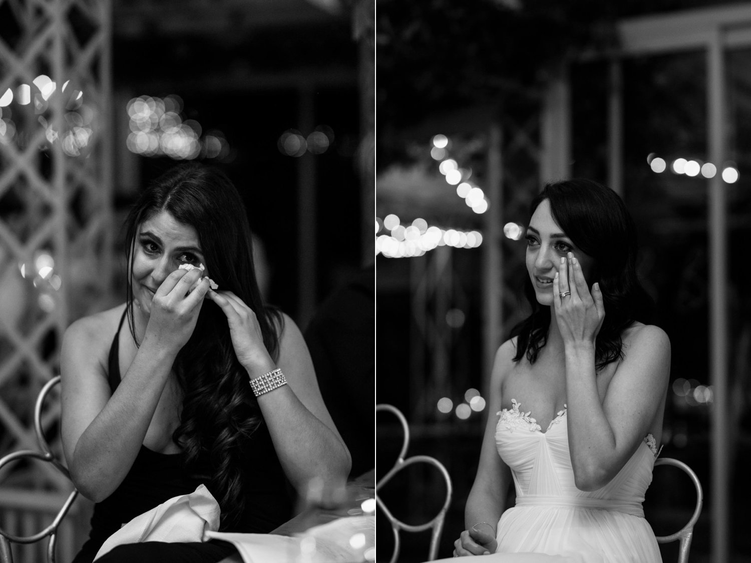 Emotional bride and sister listening to groom's wedding speech