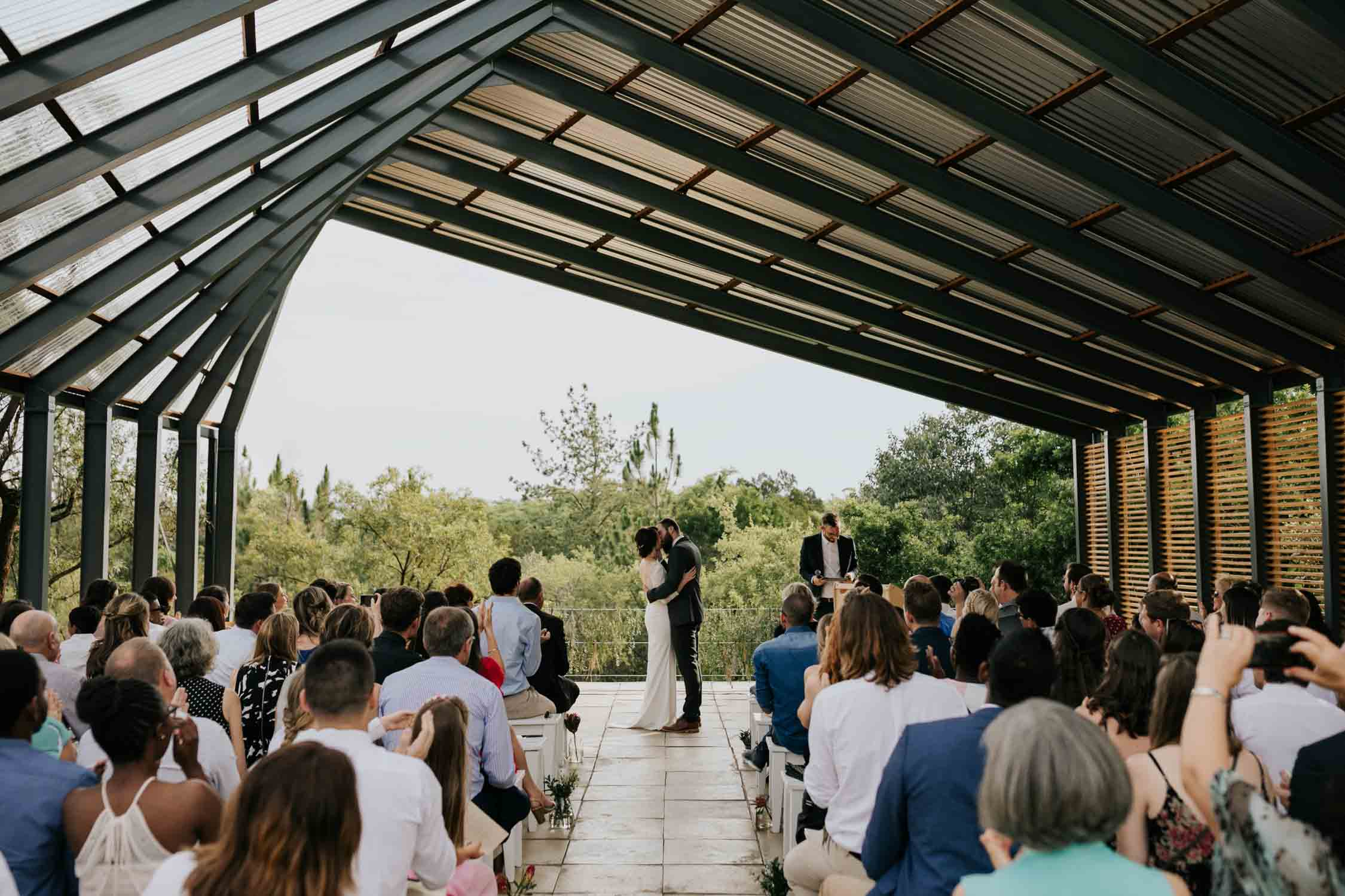 Epic first kiss photo at The Greenhouse Cafe Wedding Venue at Rosemary Hill Farm, Pretoria