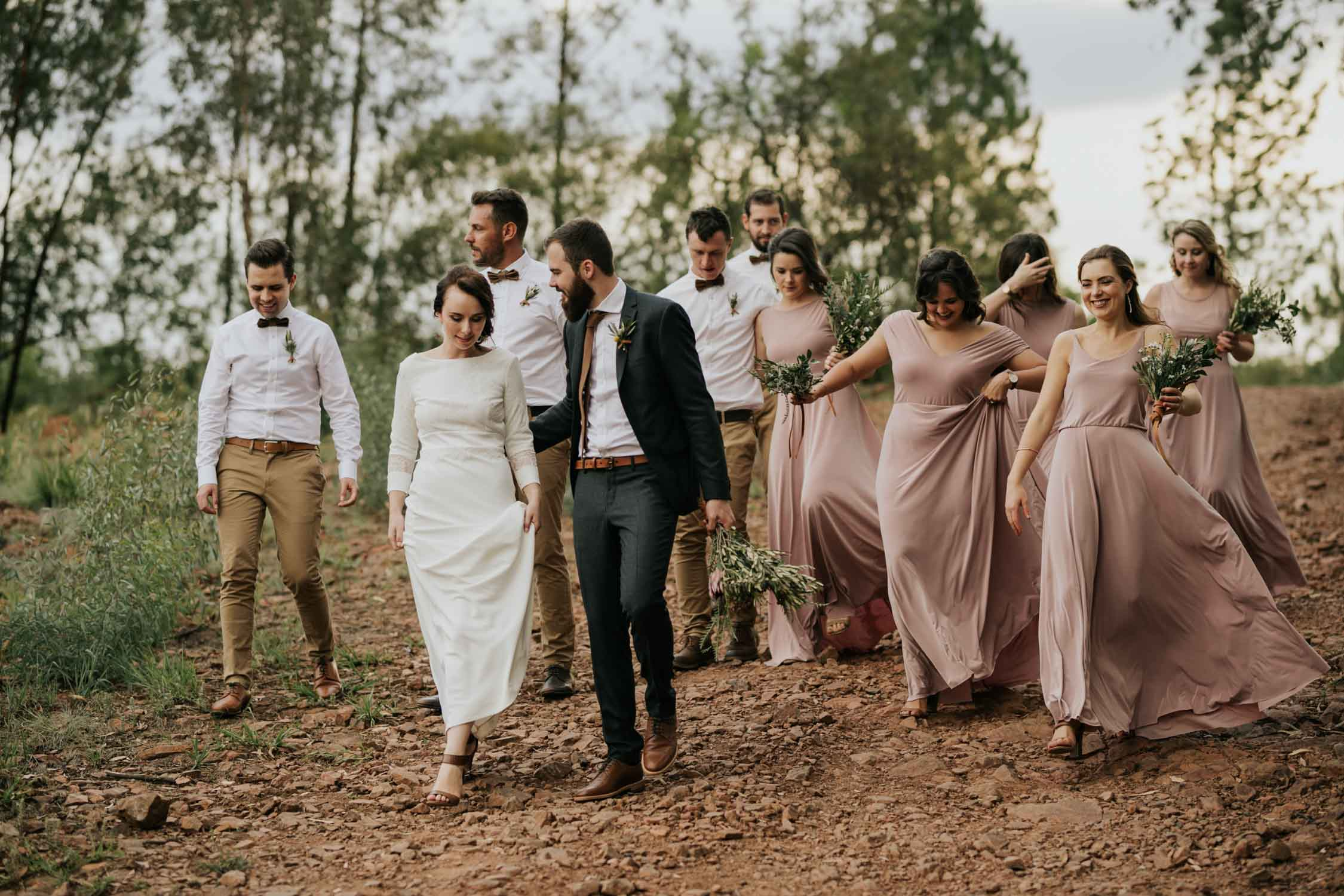 Candid bridal party portrait of the group walking together