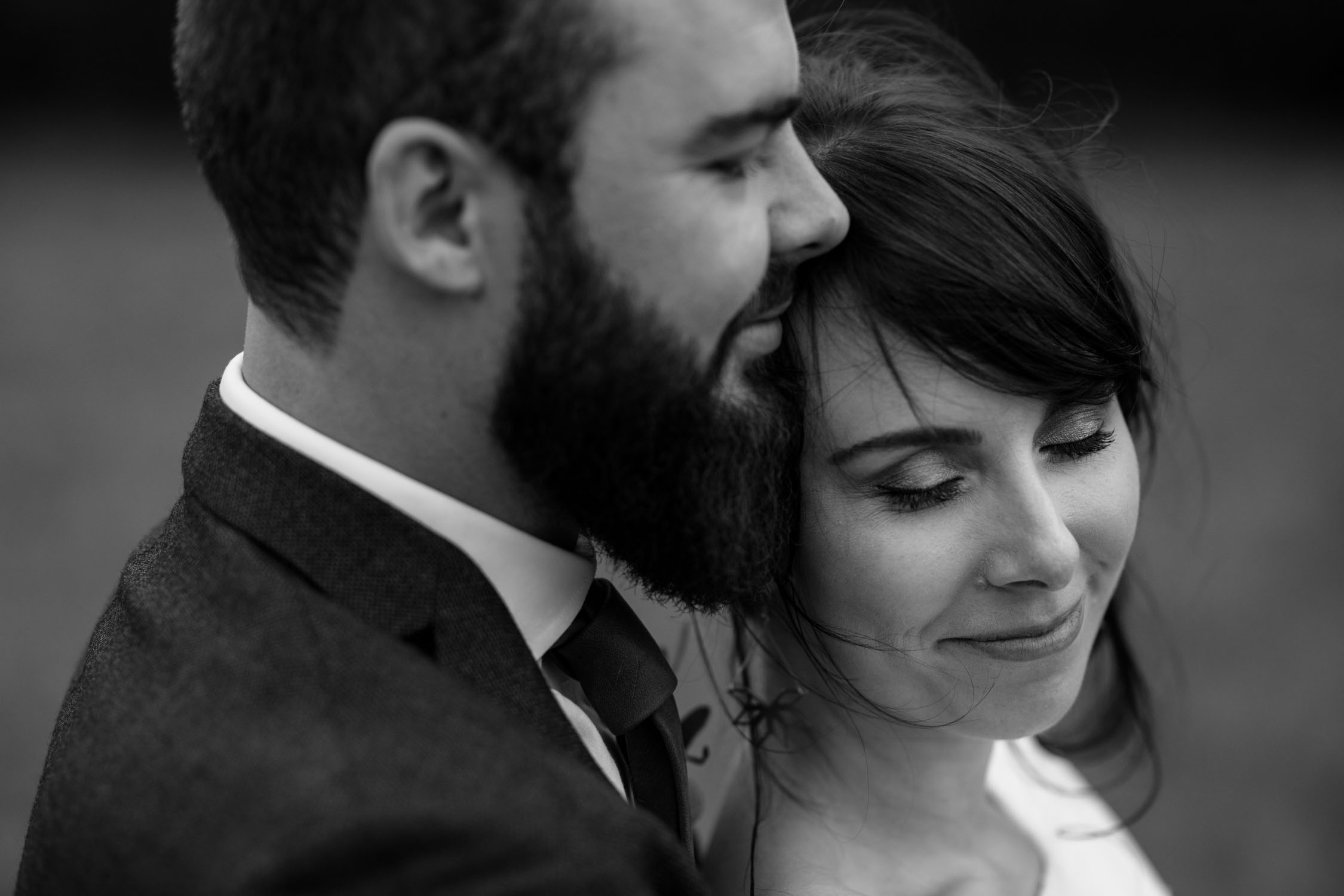 Honest moment shared by bride and groom captured by best Vancouver Wedding Photographer