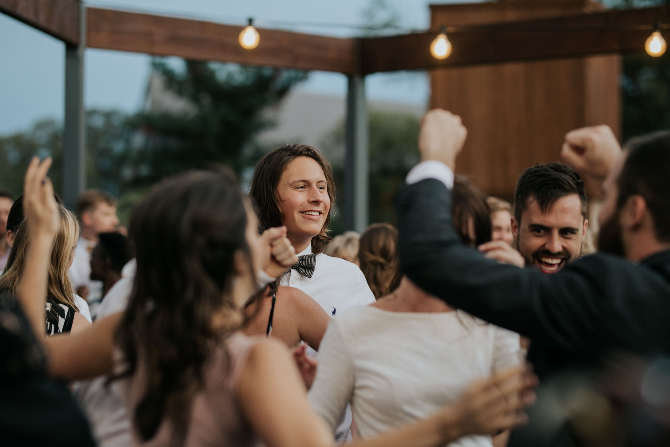 Epic dance photos at wedding using natural light and no camera flash