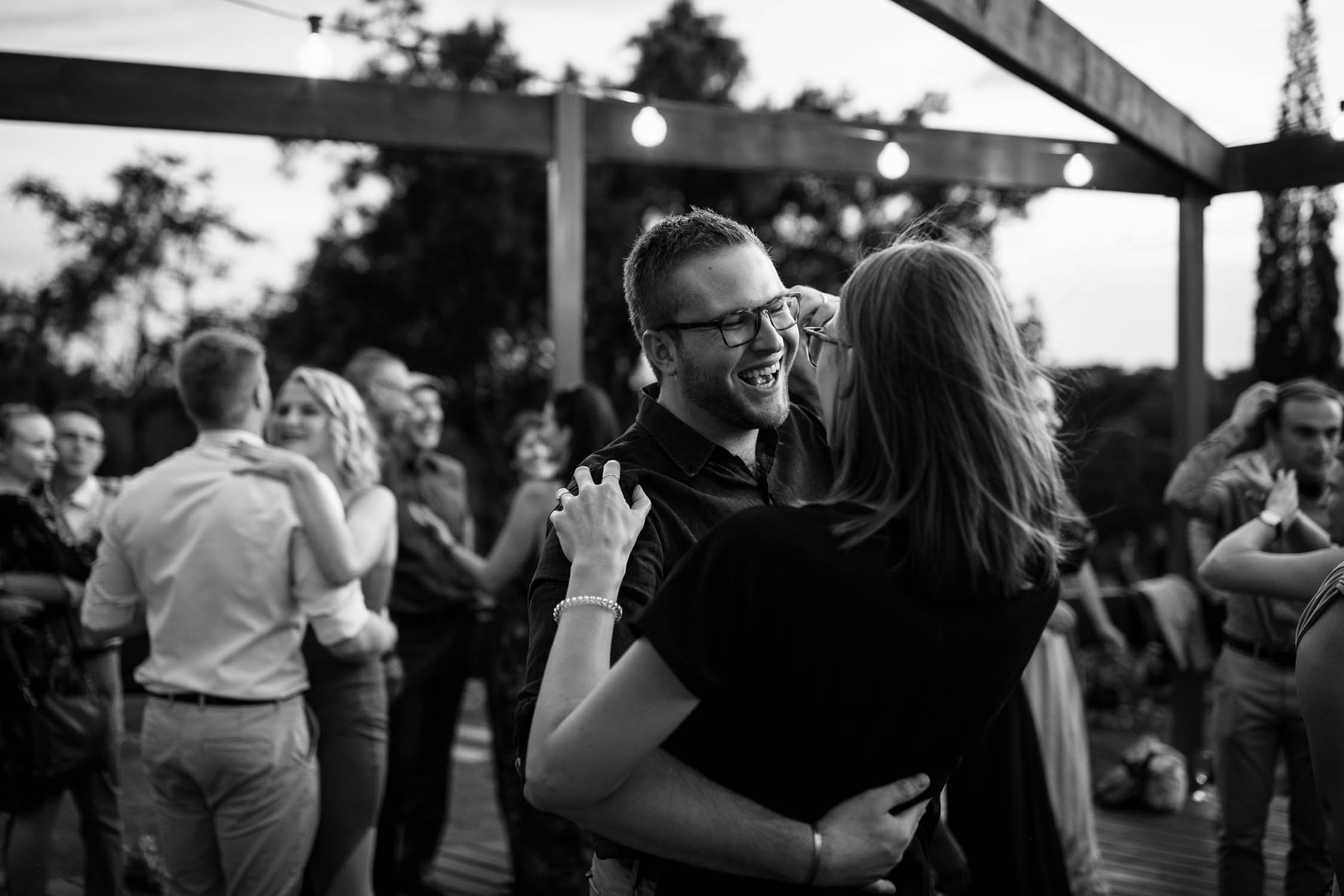 Photojournalistic moment of guests dancing at wedding taken by authentic and creative Vancouver Wedding Photographer
