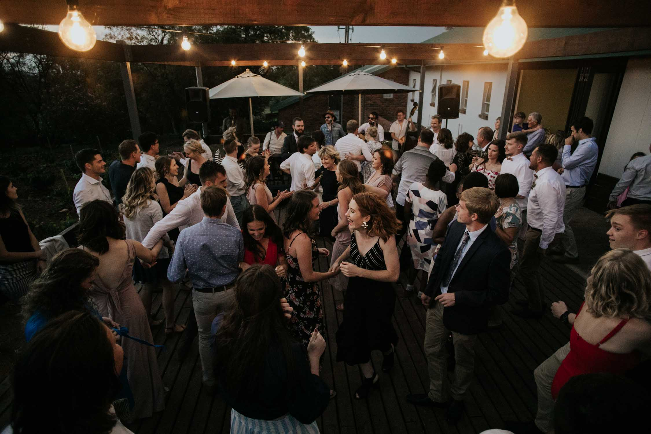 Wedding guests go wild on the dance floor to live band