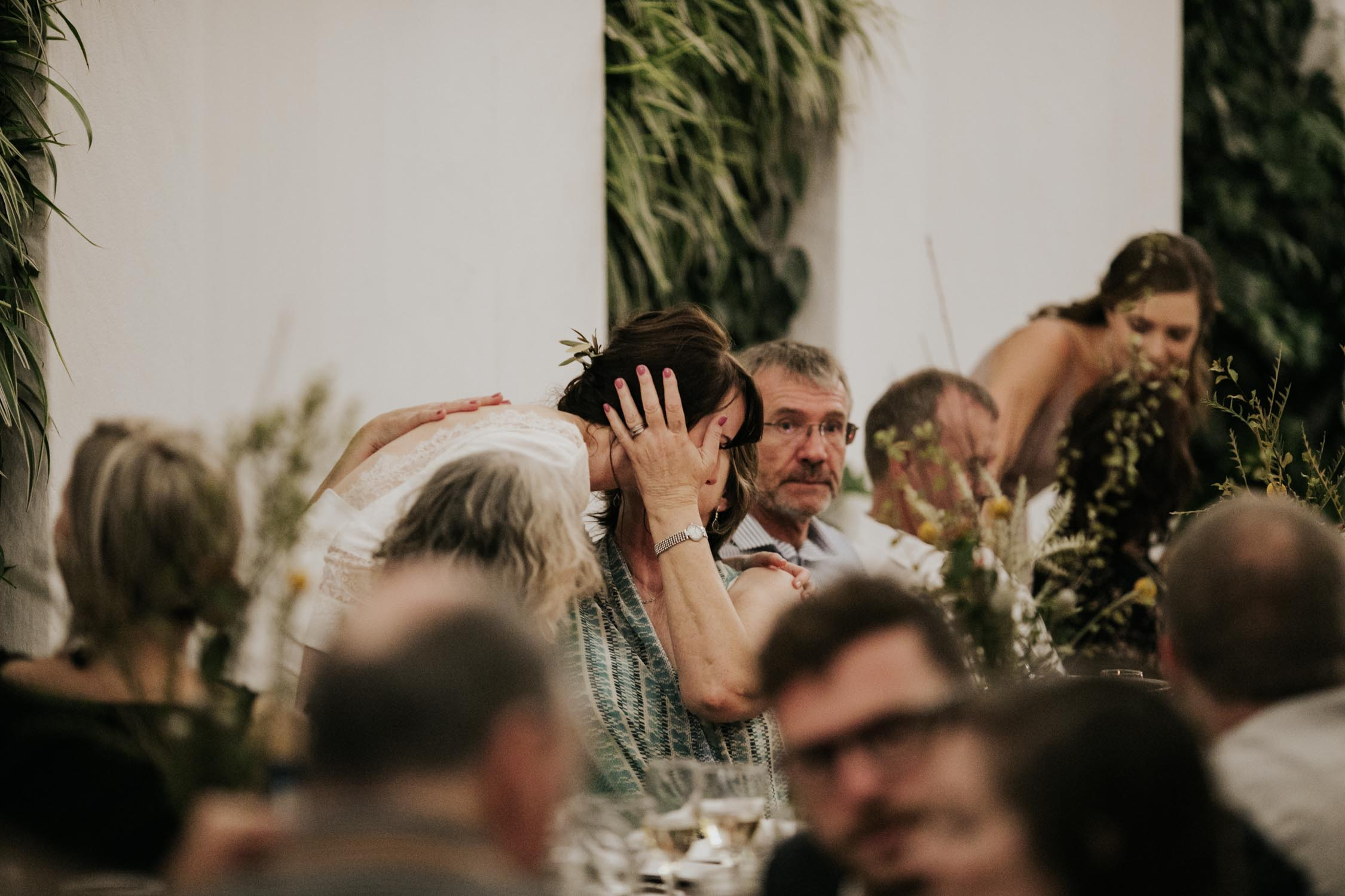 Candid and natural photo of guest at wedding ceremony held at The Pipe Shop Wedding Venue in Vancouver, BC