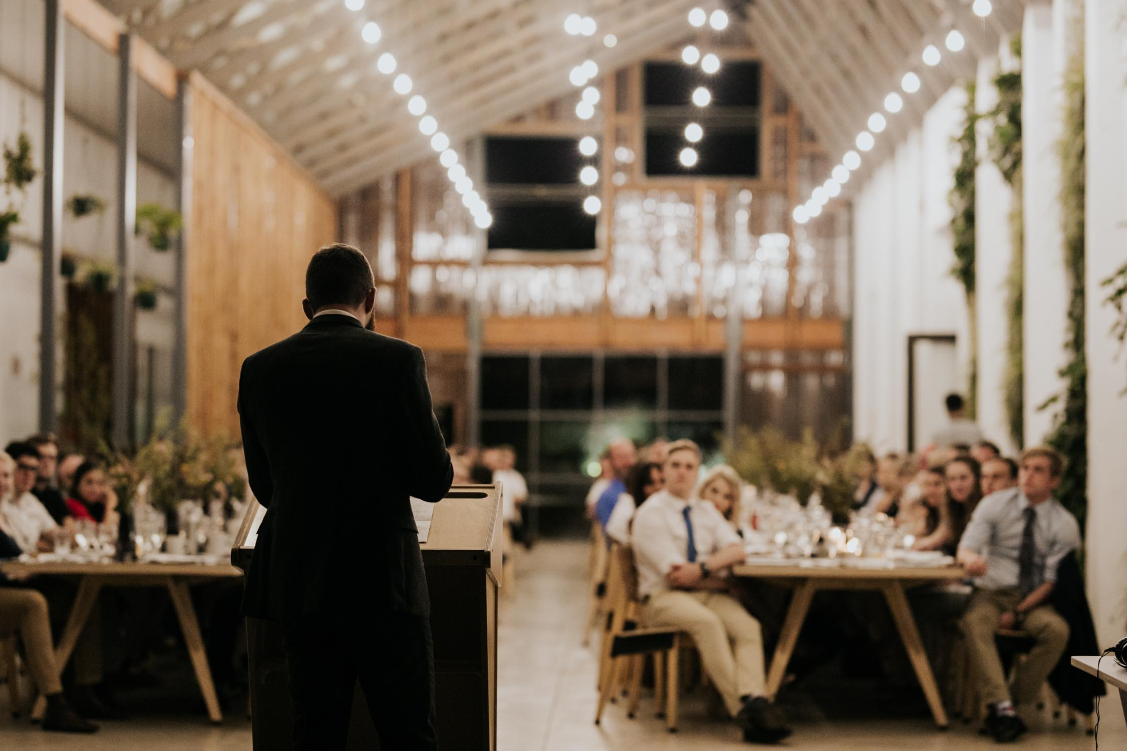 Groom saying an emotional speech to his bride at modern industrial Vancouver wedding