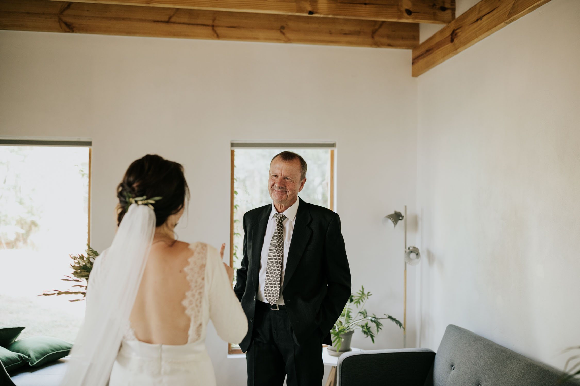 Father of the bride's emotional reaction when he sees his daughter in her wedding dress