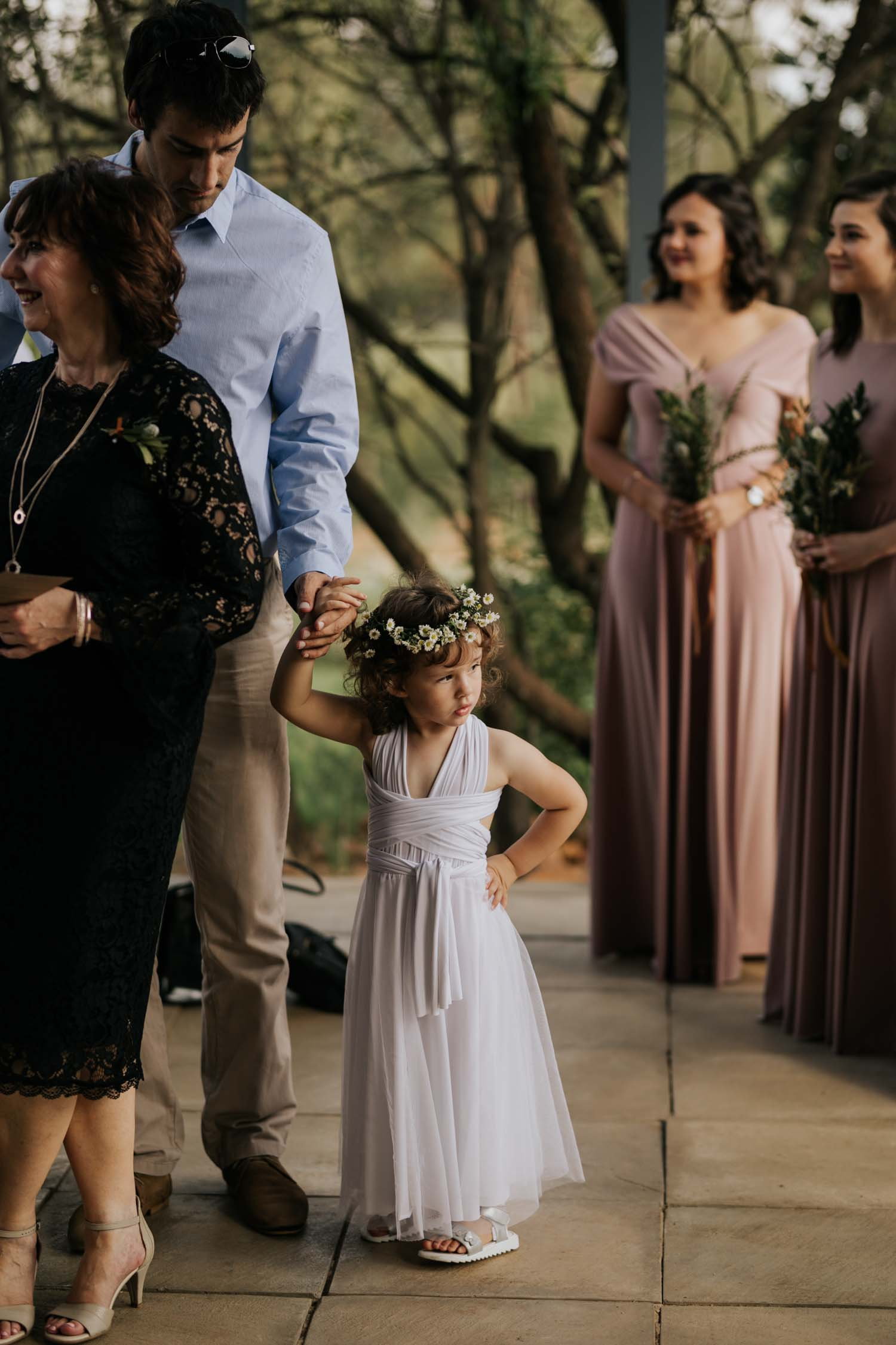 Cute flower girl outfit wearing white wrapped dress, sliver sandals and daisy flower crown