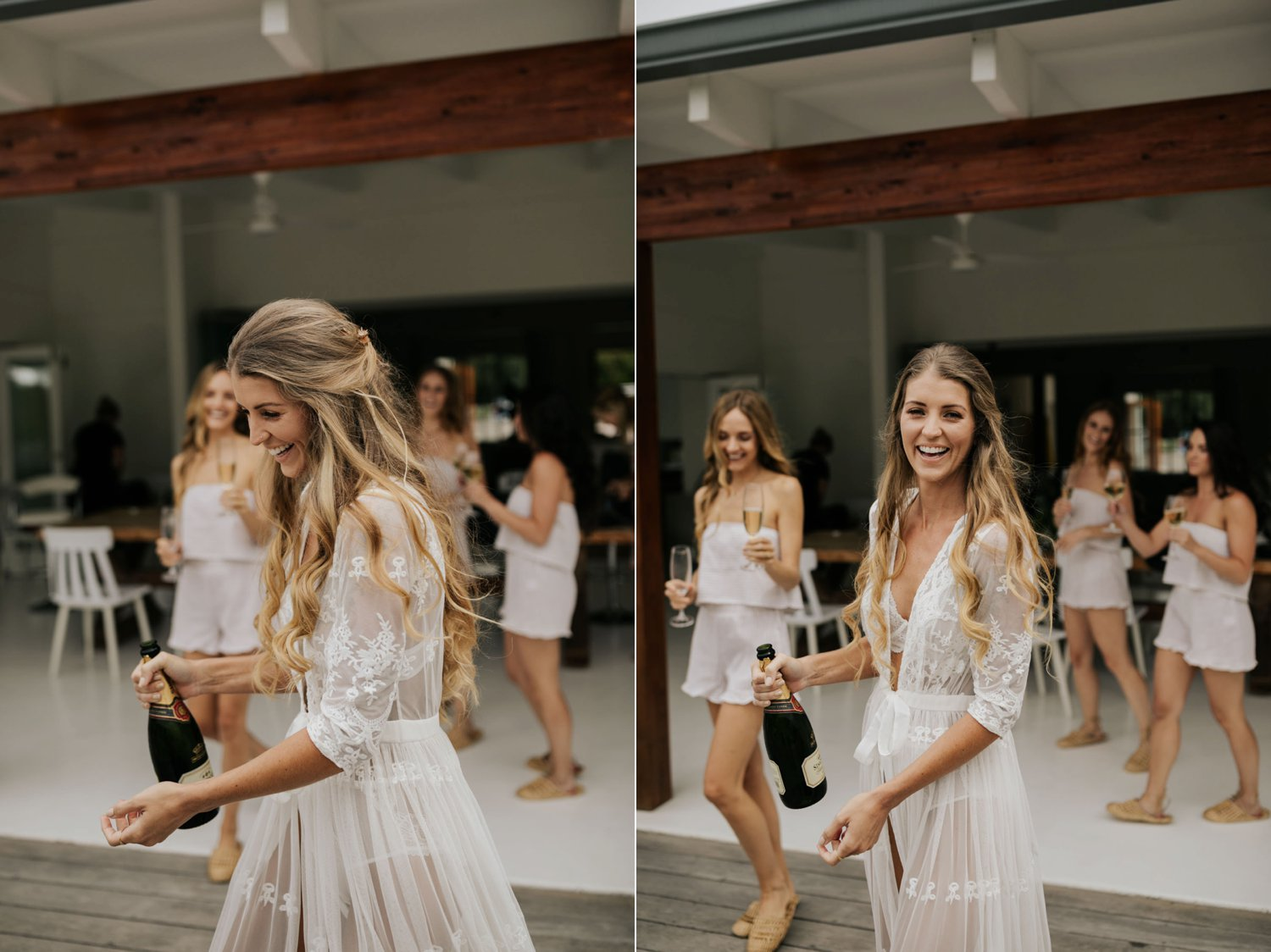 Boho bride with long curly hair dressed in white lace PJs and gown pops champagne with her bridesmaids