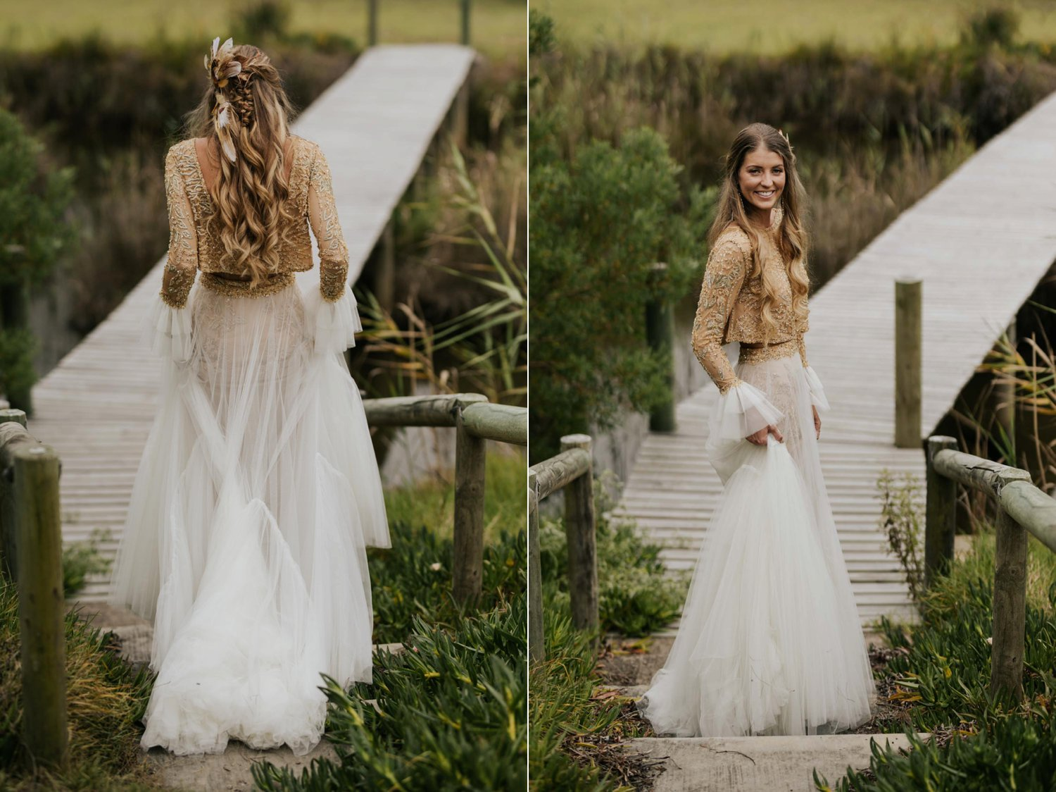 Bohemian bride with long curly blonde hair wears two piece gold and cream long sleeve wedding dress and feathers and plait in her hair