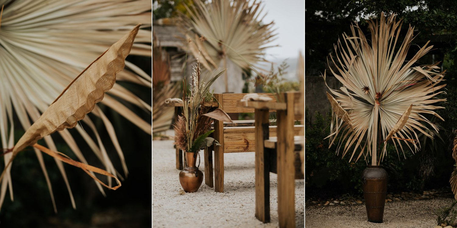 Dried palms and flowers, brass pots and feather for boho inspired wedding ceremony