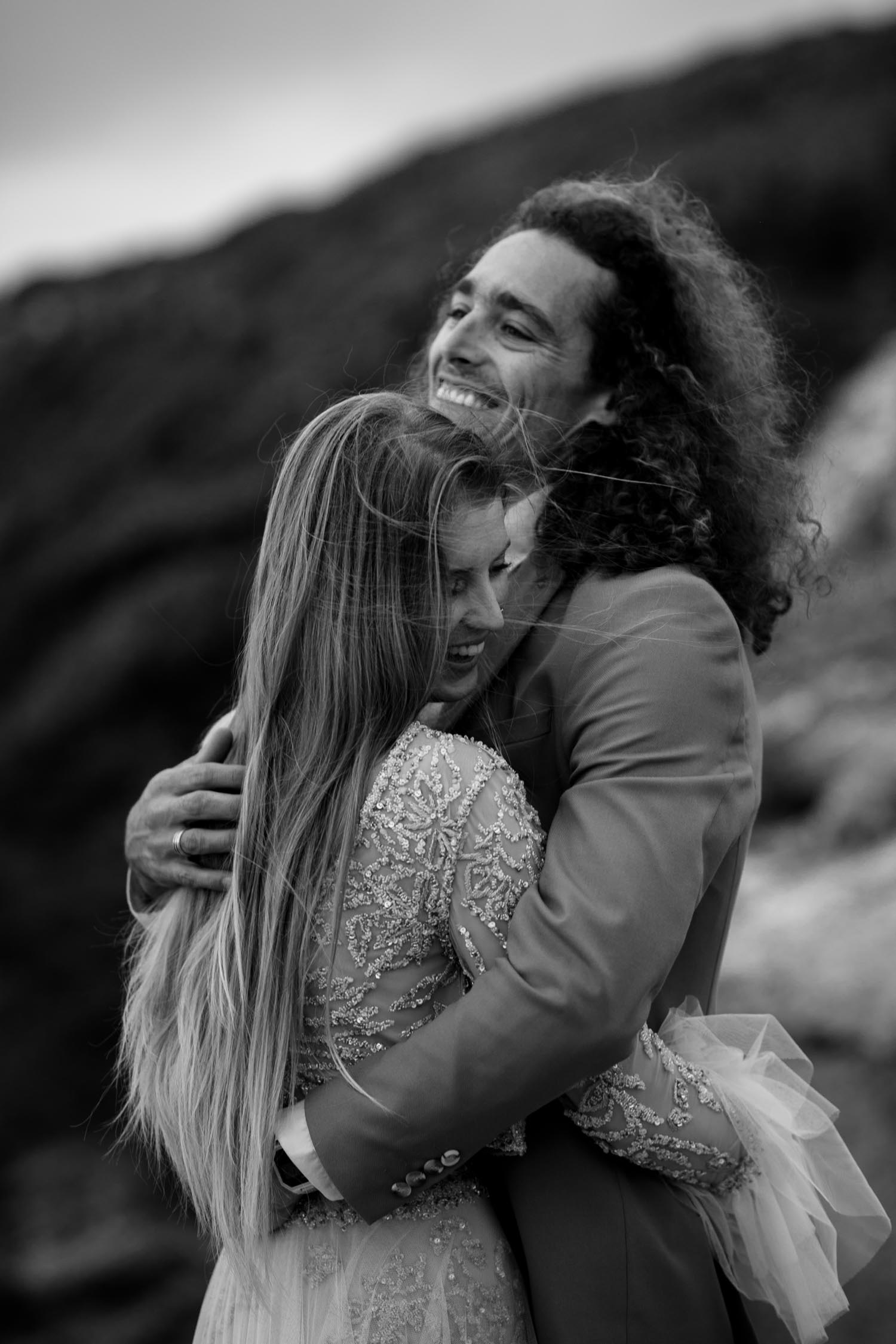 Wild and windy moody photo portrait session of bride and groom at Cannon beach