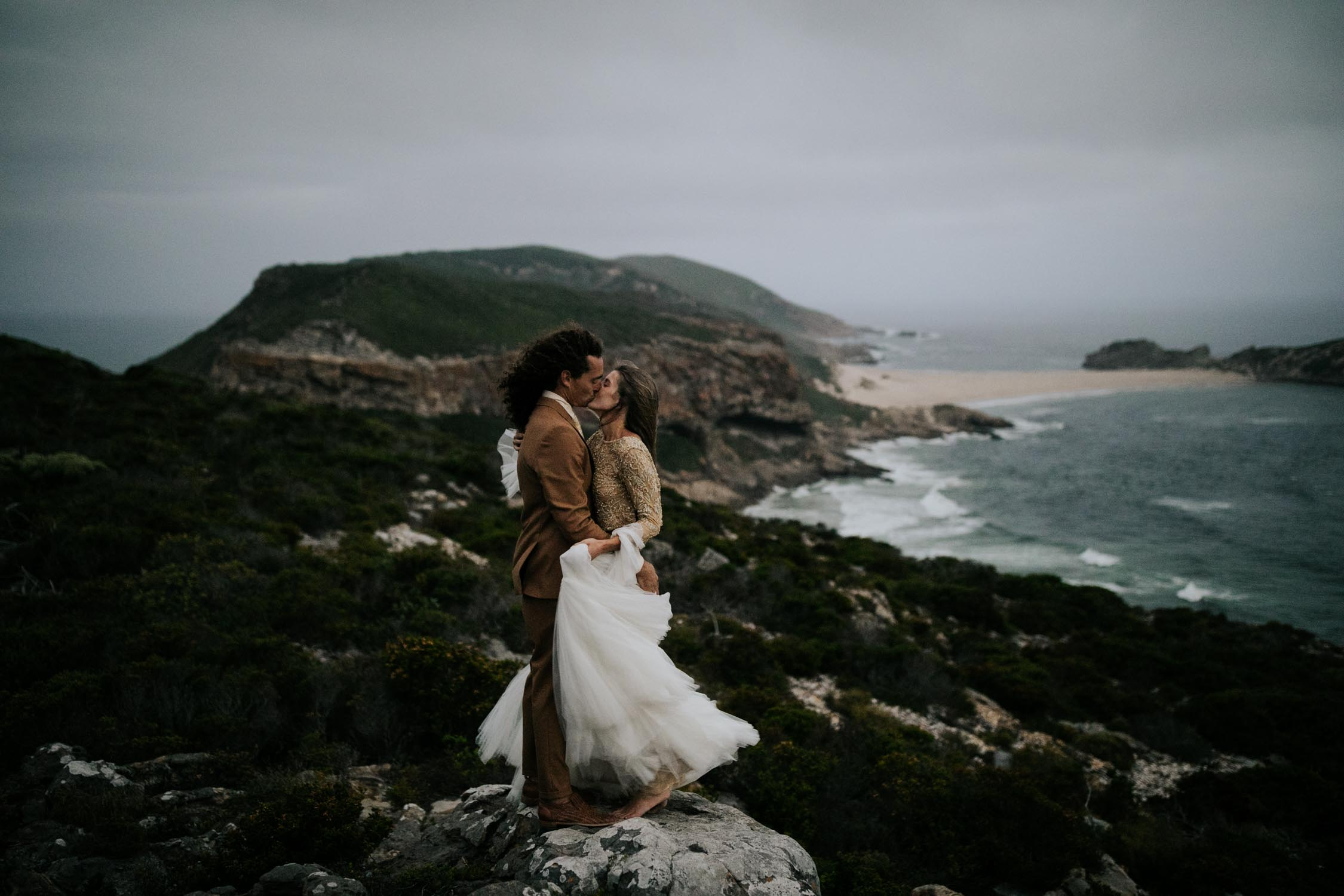 Epic Love over the ocean photo taken by adventure Vancouver Wedding Photographer