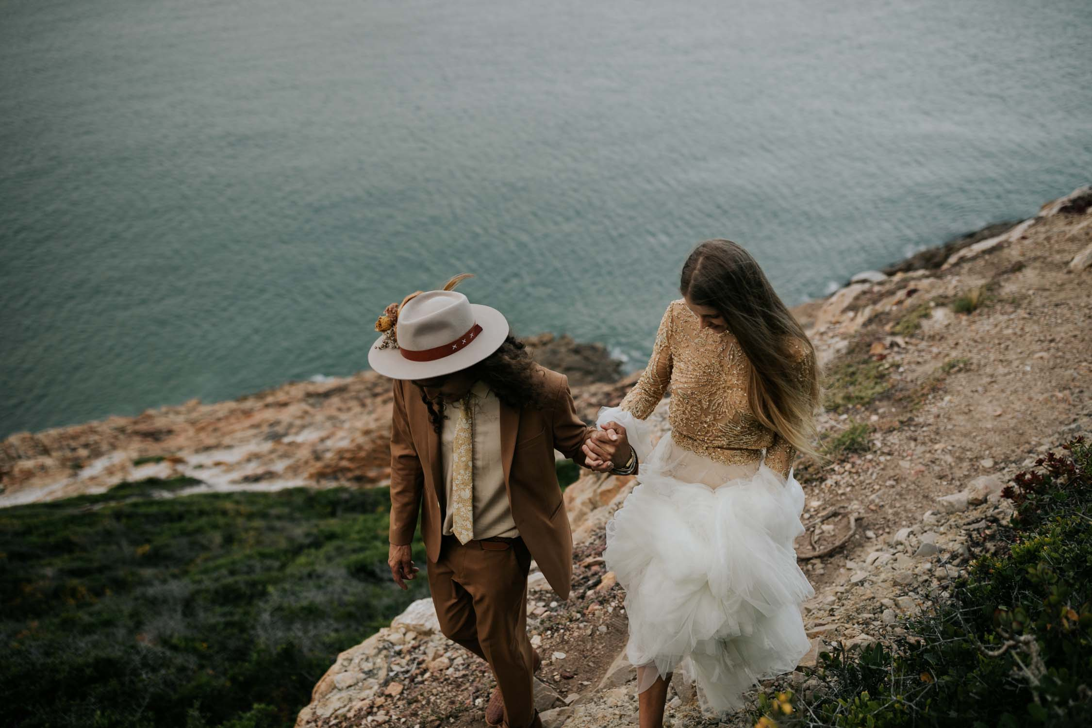 Adventurous wedding couple take their wedding photos in epic Robberg Nature Reserve, Plett, Garden Route, South Africa