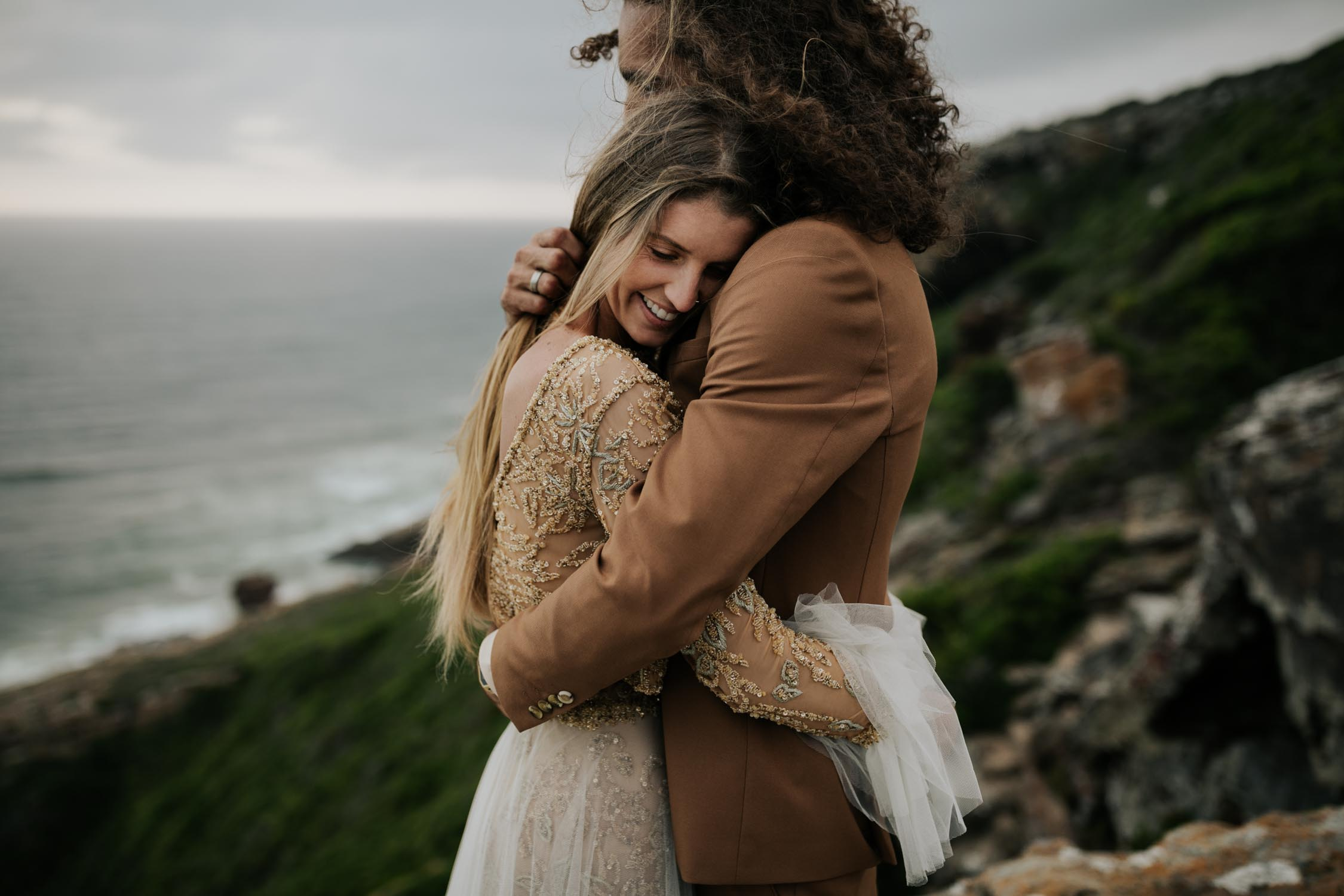 Bride and groom embrace beach wedding portrait session