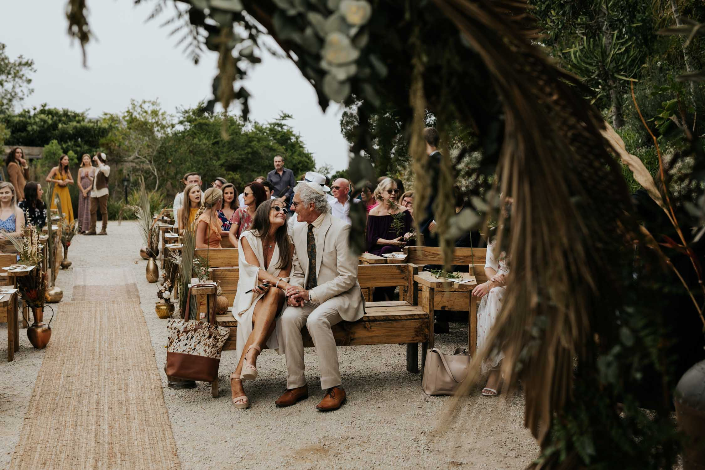 Photojournalistic photo on mom and dad at Boho wedding by Vancouver Wedding Photographer