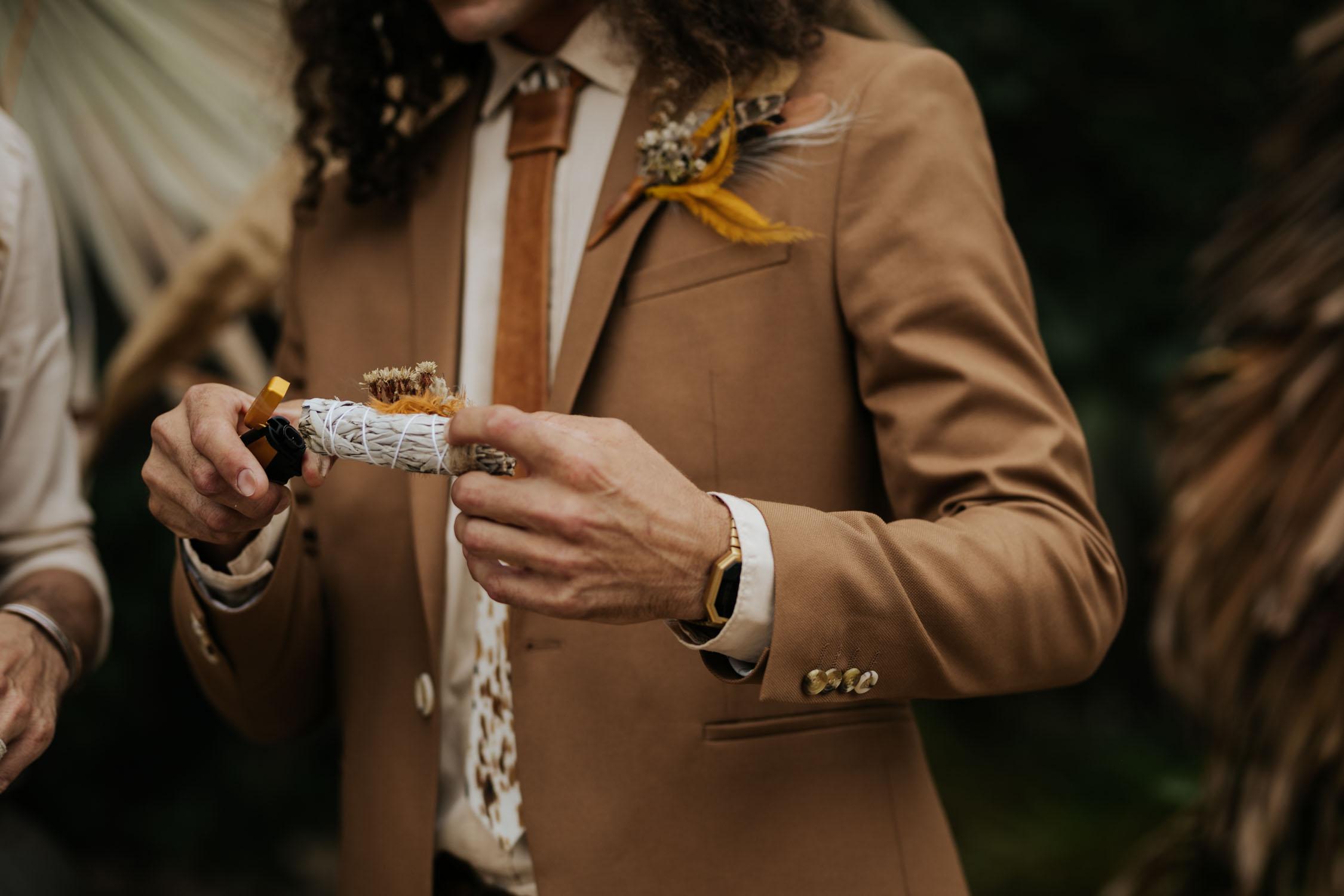 Untraditional sacred sage smudging sticks at boho gypsy wedding ceremony