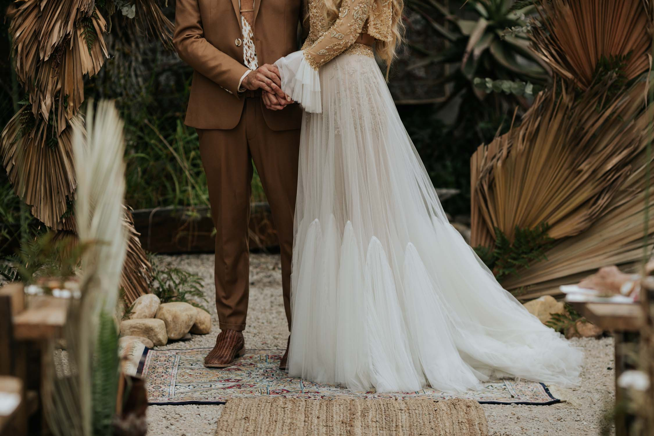 Boho bride wedding dress with flared long sleeves, sheer skirt and gold detailed top