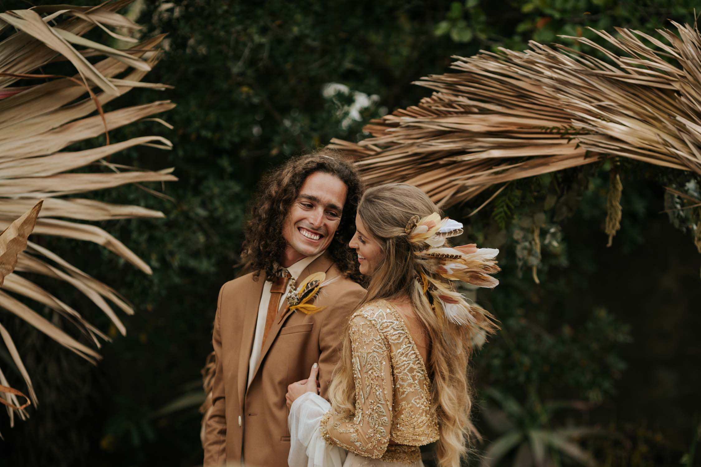 Good looking long haired bohemian gypsy wild and free wedding couple