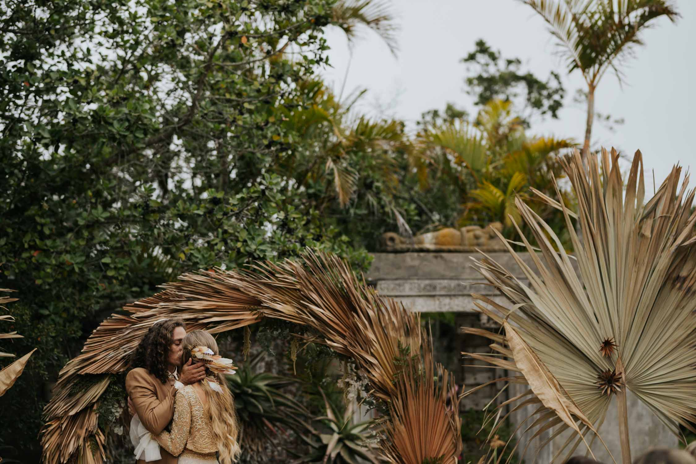 The best first kiss ever at boho inspired wedding