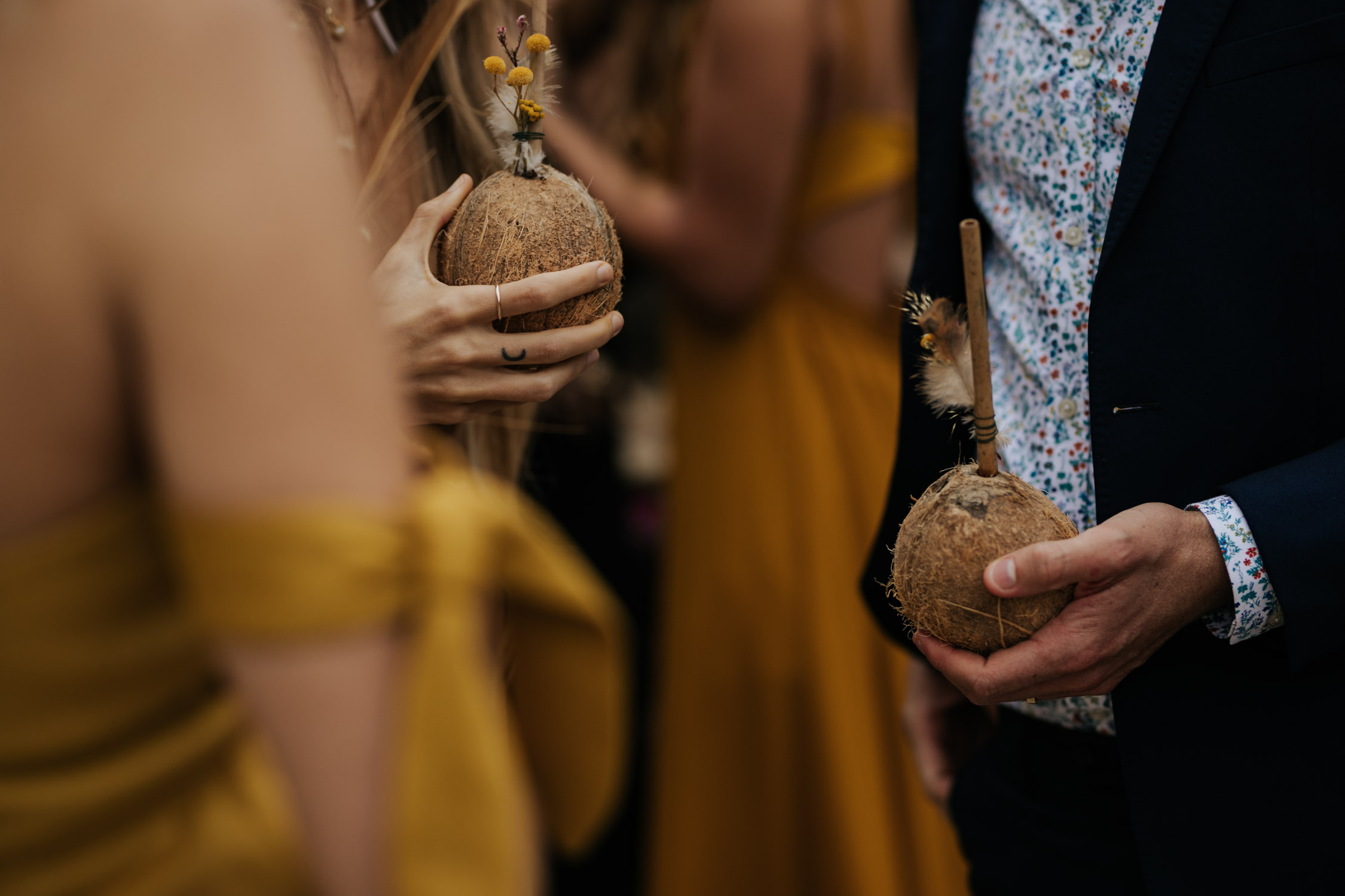 Real coconuts after boho wedding ceremony for cocktail hour