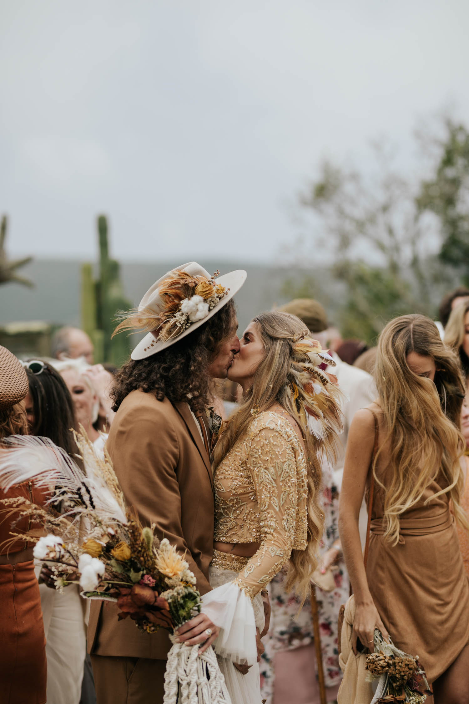 Candid moment of bride and groom kissing at intimate destination wedding in South Africa