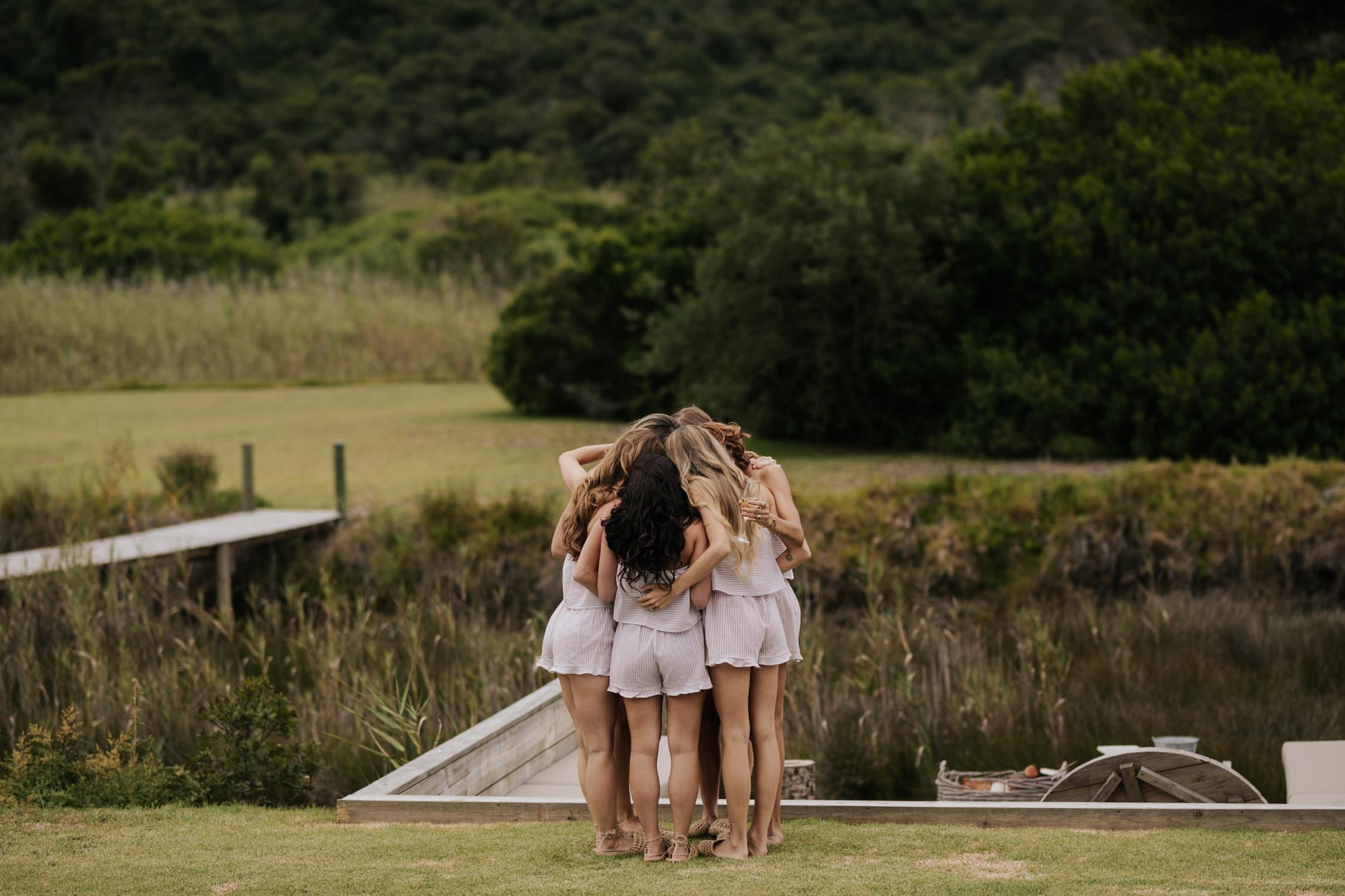 Bridesmaids in their boho striped matching PJs while getting ready from wedding at Emily Moon in Plett