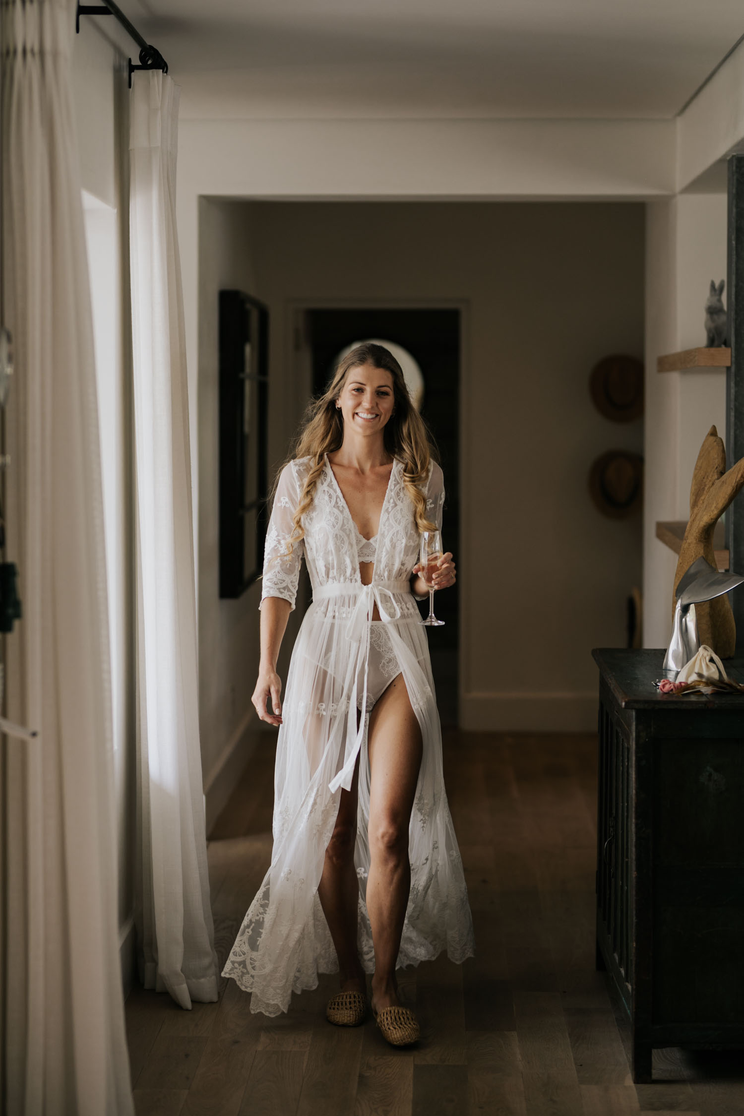 Beautiful boho bride lace gown for getting ready wedding photos