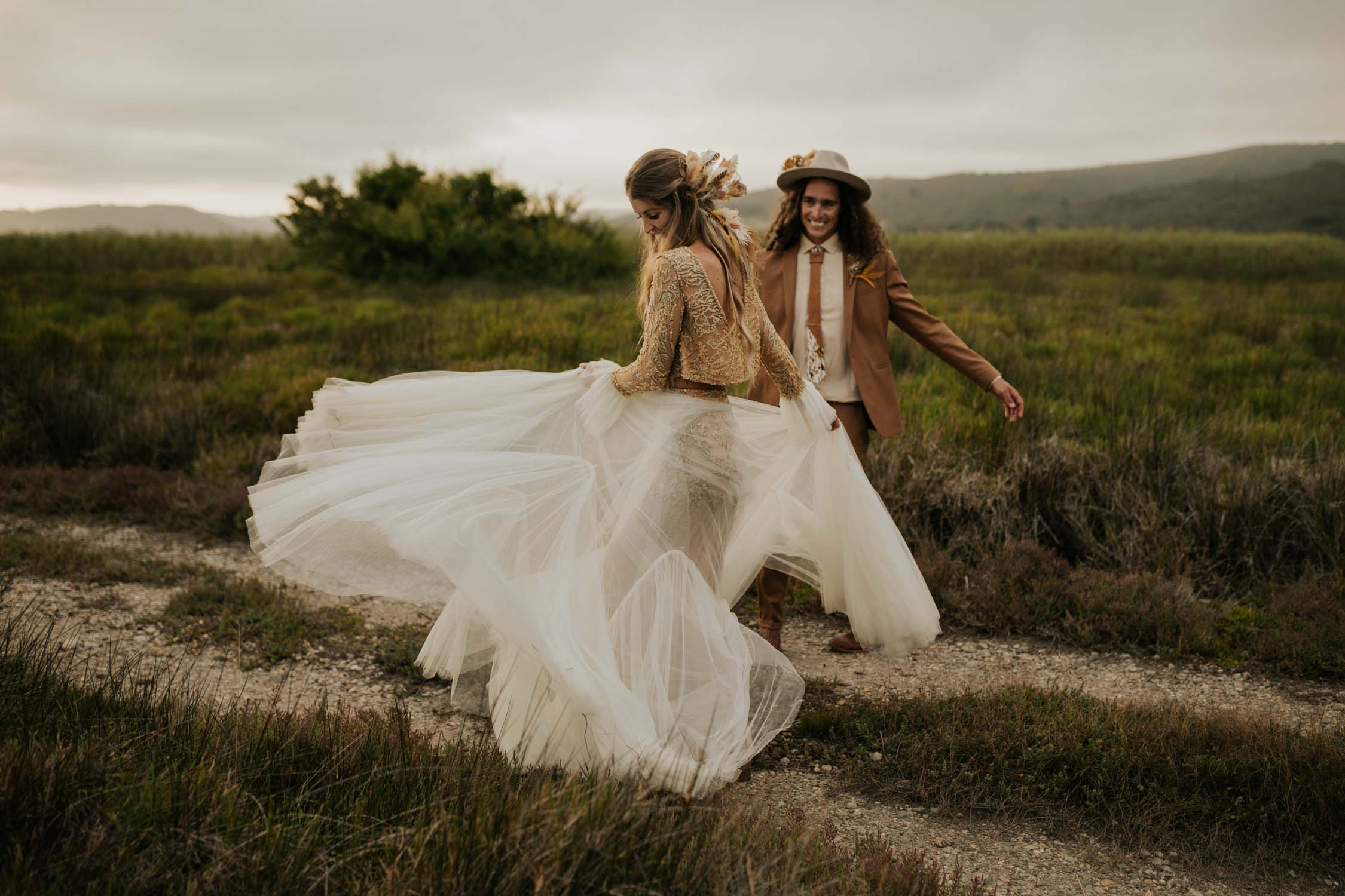 Candid and adventure Vancouver Wedding Photographer takes amazing romantic photo of boho bride and groom spinning at destination wedding in South Africa