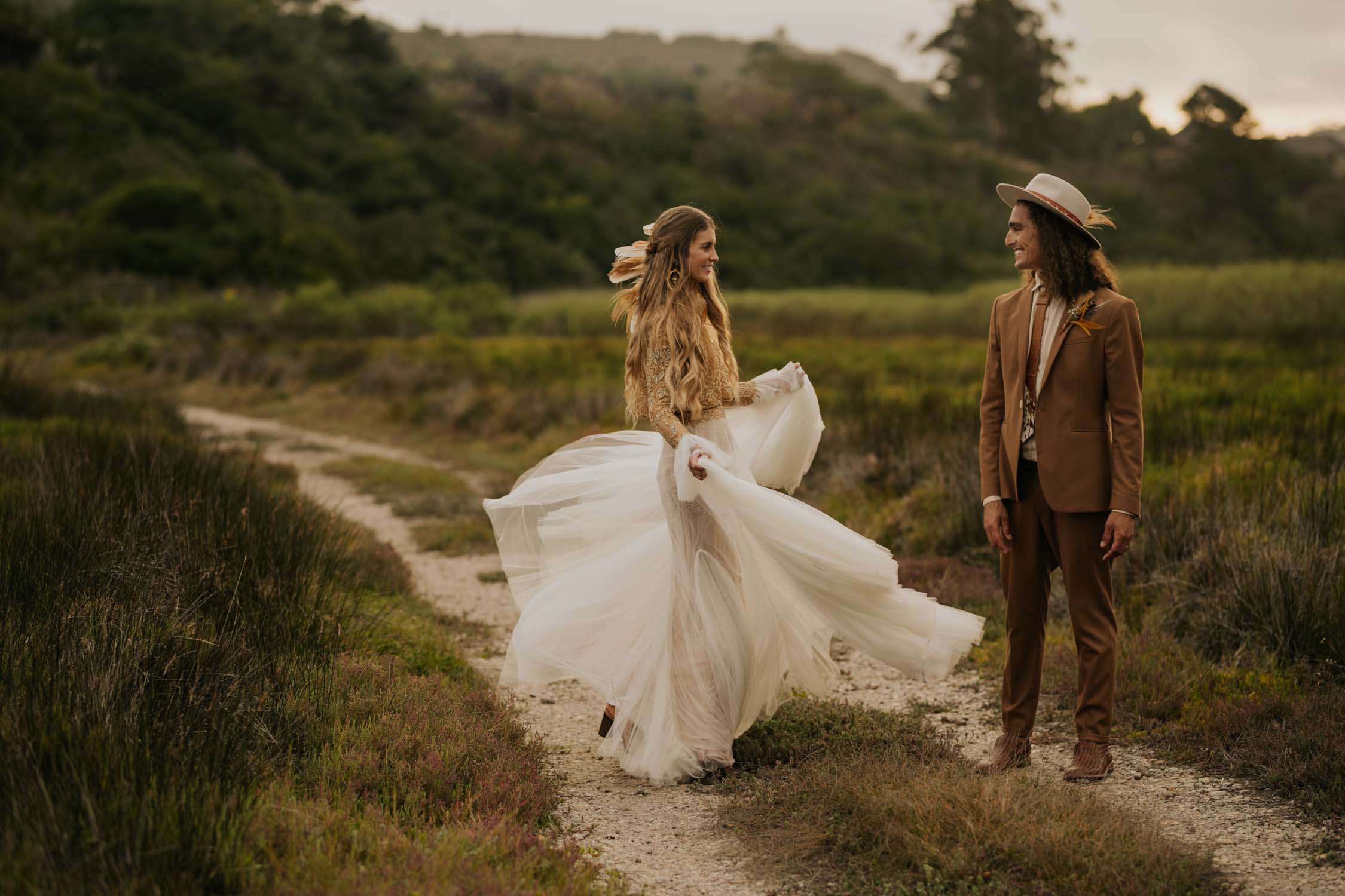 Award winning Vancouver Wedding Photographer takes amazing romantic photo of boho bride spinning for groom at destination wedding