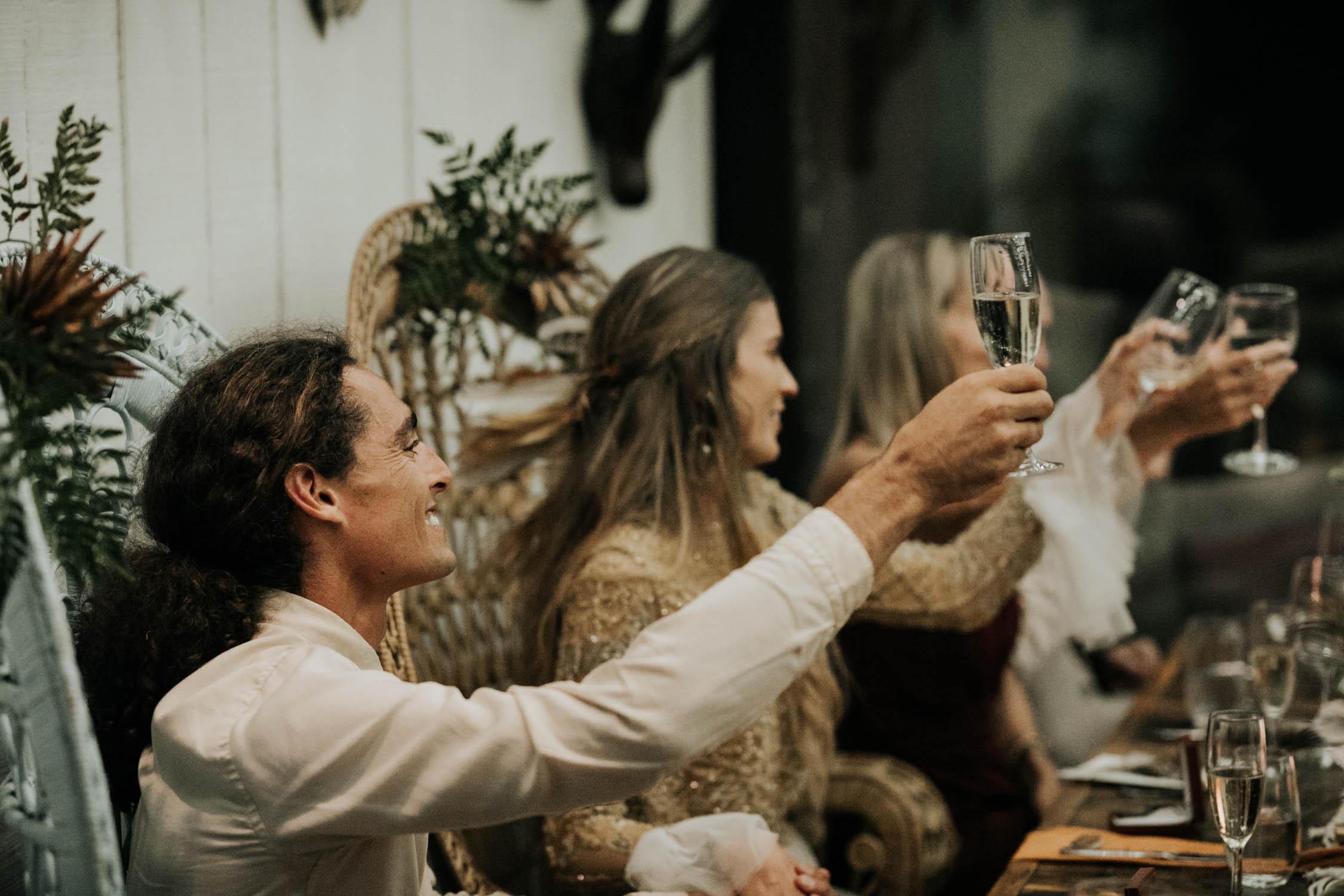 Toast during boho wedding reception