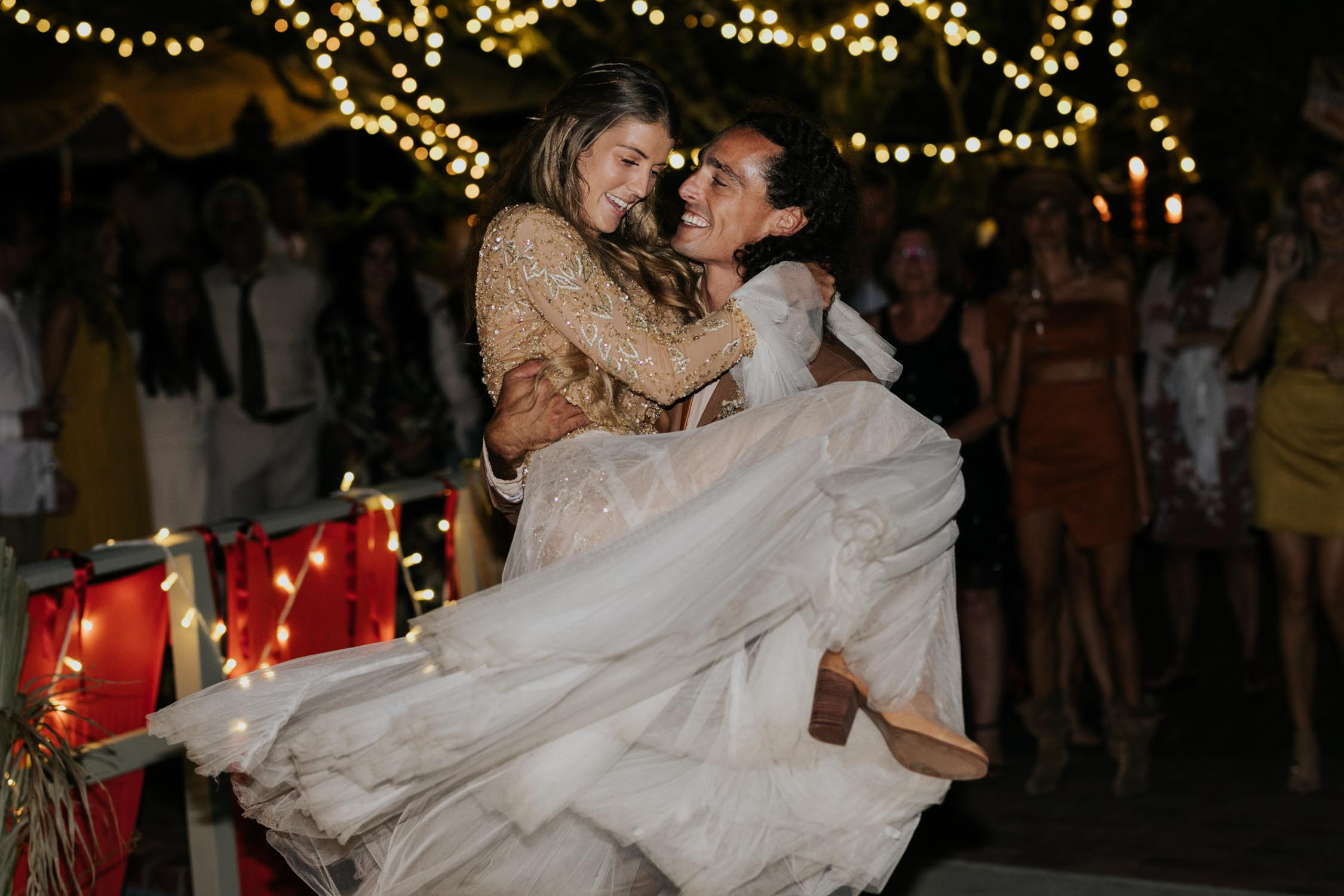 Grooms picks up bride and spins her around during epic first dance