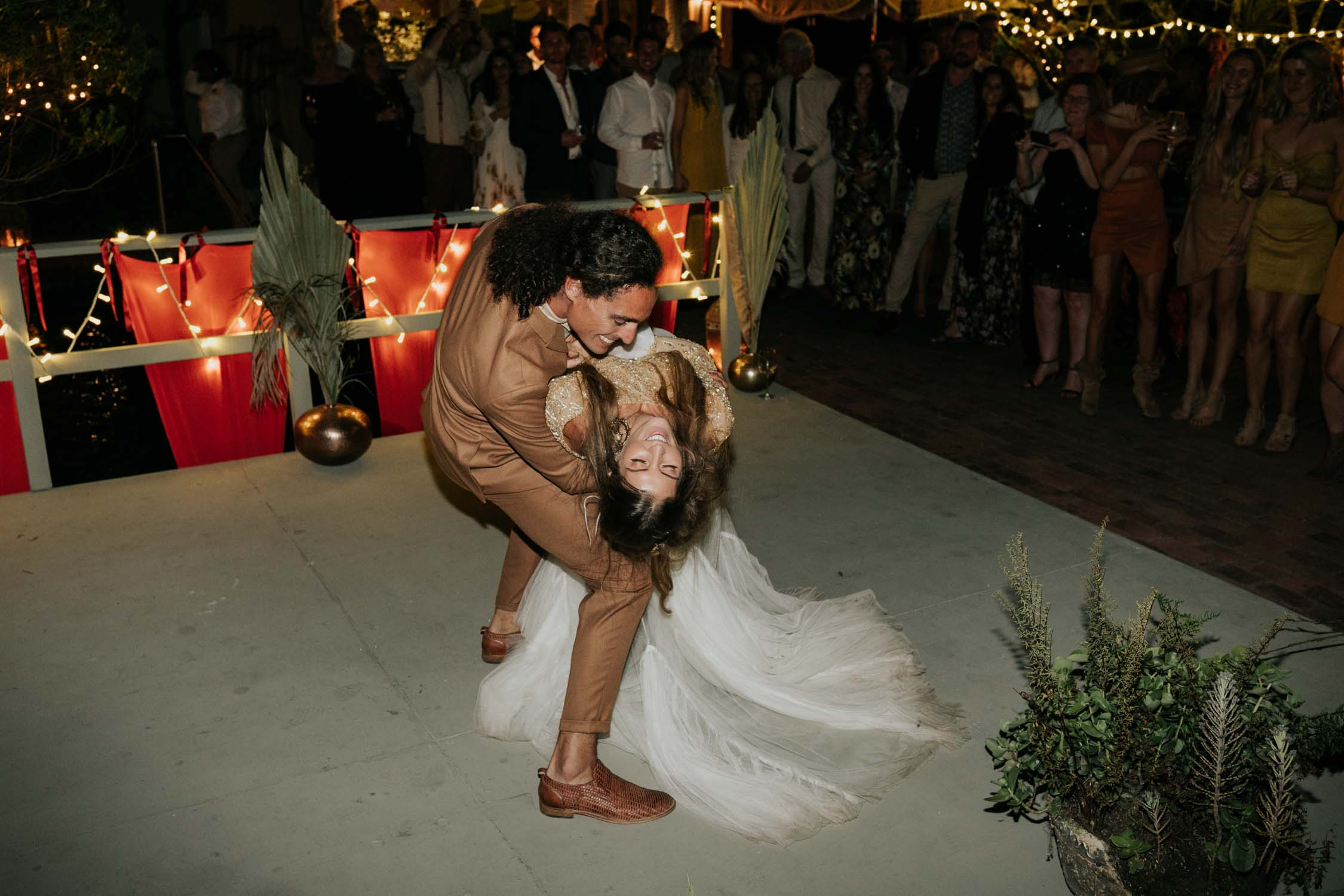 Grooms dips bride and spins her around during epic first dance at Emily Moon