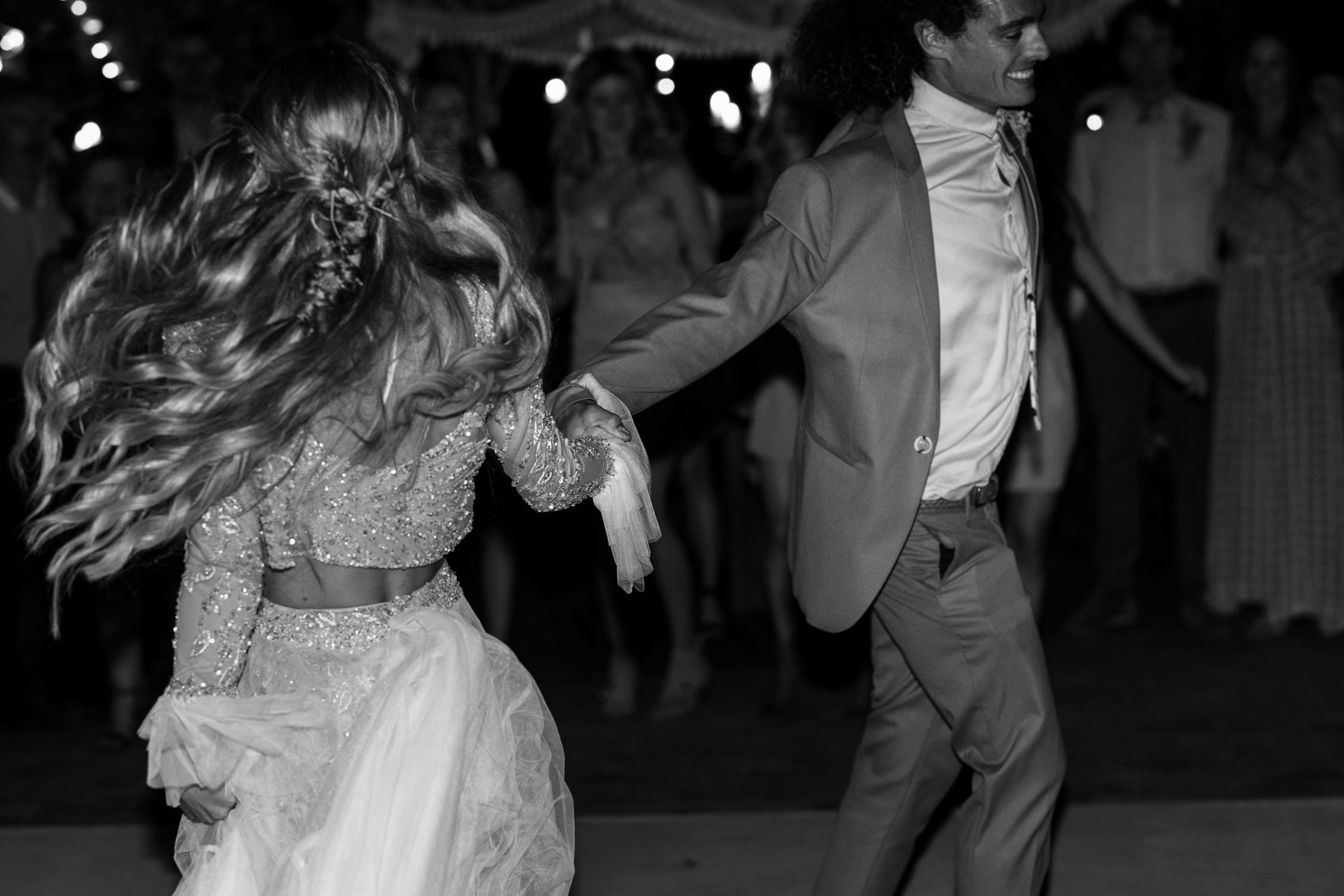 Grooms and bride spin during epic first dance