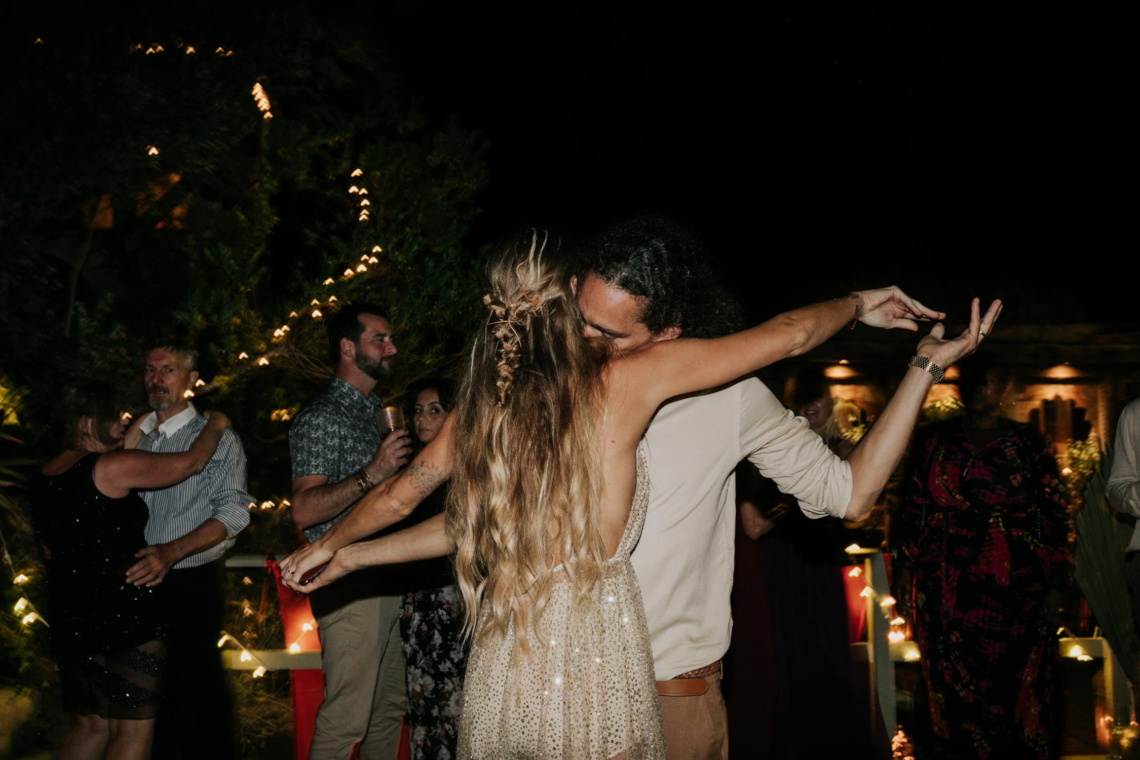 Bride wears sheer golden glitter boho wedding dress for dancing at wedding