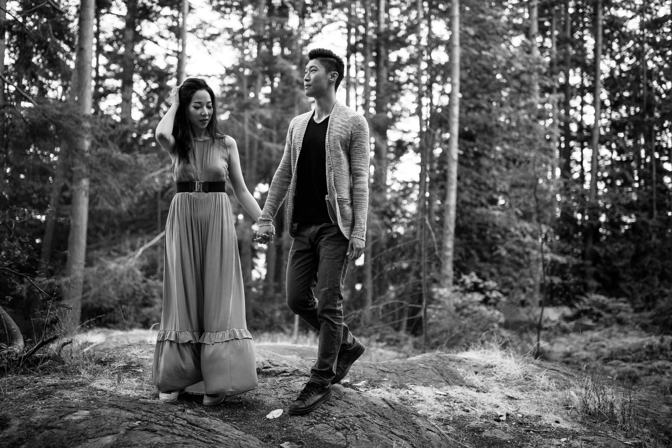 Documentary style candid black and white engagement shoot photo of Asian couple at Lighthouse Park