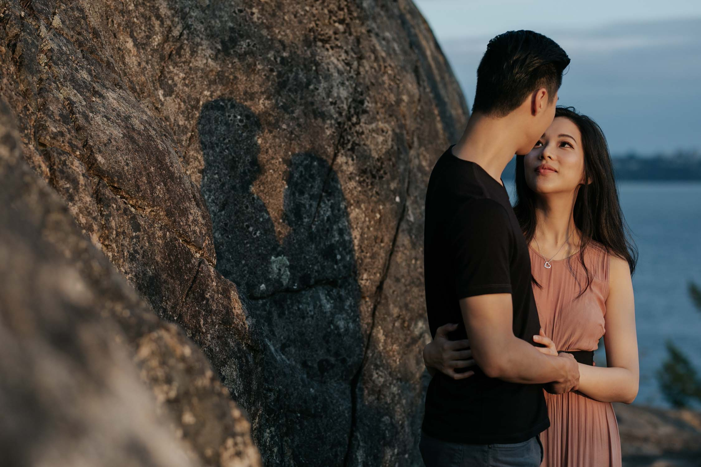 Engaged Asian couple during romantic non posed engagement shoot in West Vancouver