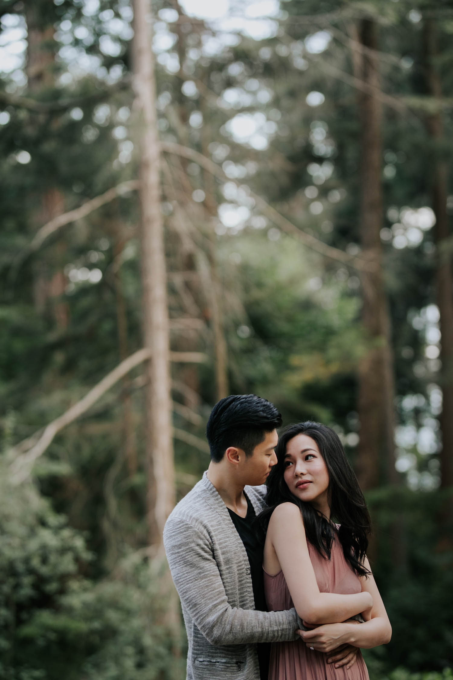 Candid Wedding Photographer captures Asian couple's engagement photo session in Lighthouse Park
