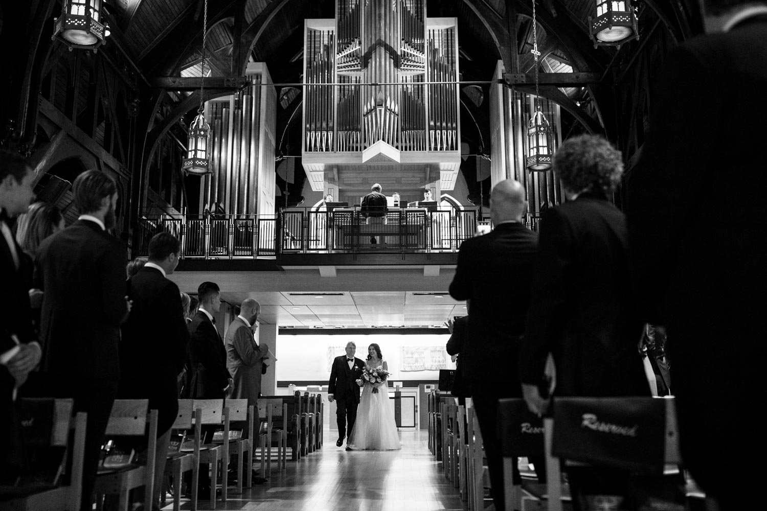 Gorgeous bride walks down the aisle with her dad in Christ Church Cathedral in Vancouver