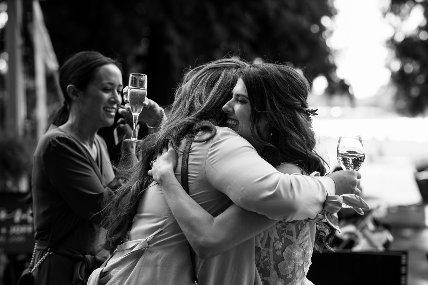 Bride greets her friends during cocktail hour at Brock House Restaurant Wedding Venue on Jericho Beach