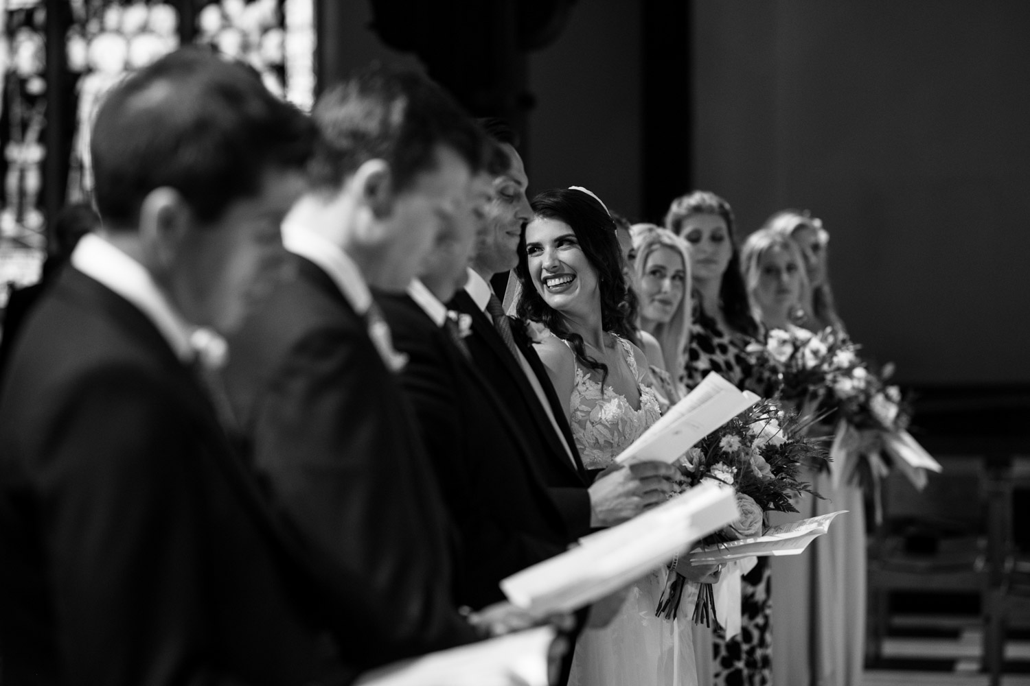 Candid Photo photojournalist moment bride smiling at guests in Christ Church Cathedral Vancouver