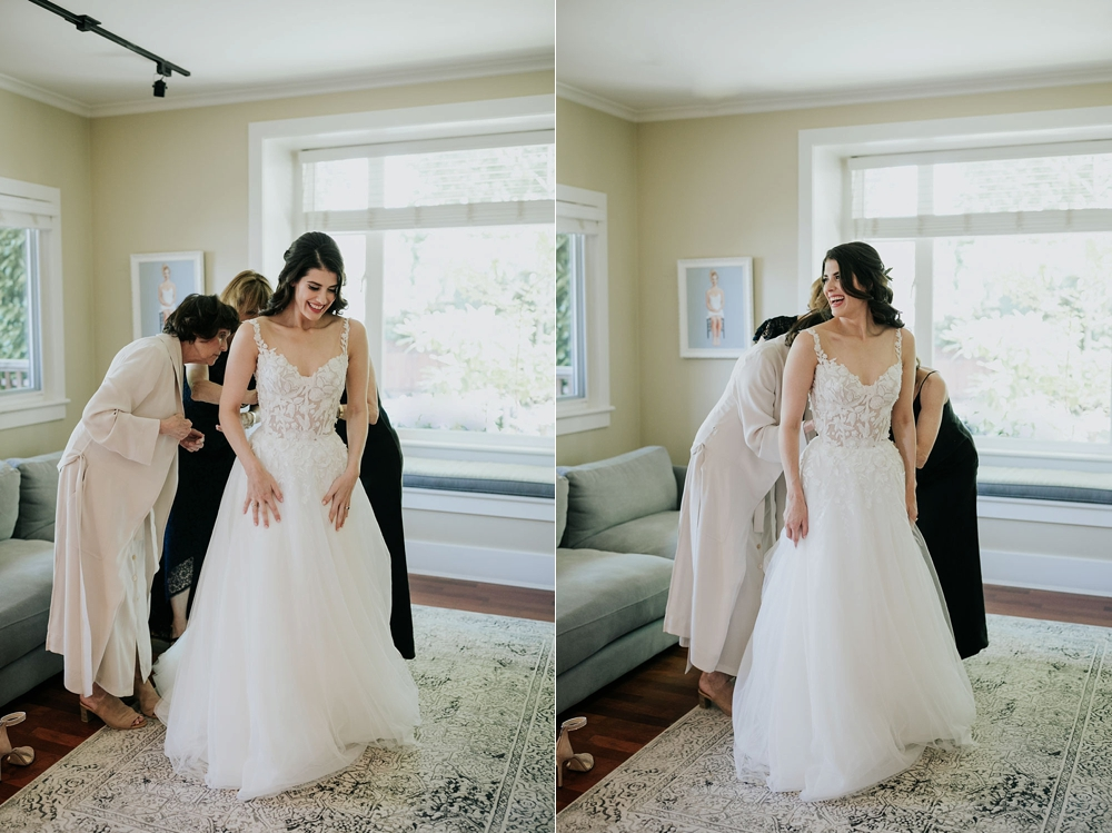 Candid moments of bride's mom helping her put her beautiful lace detailed wedding dress on