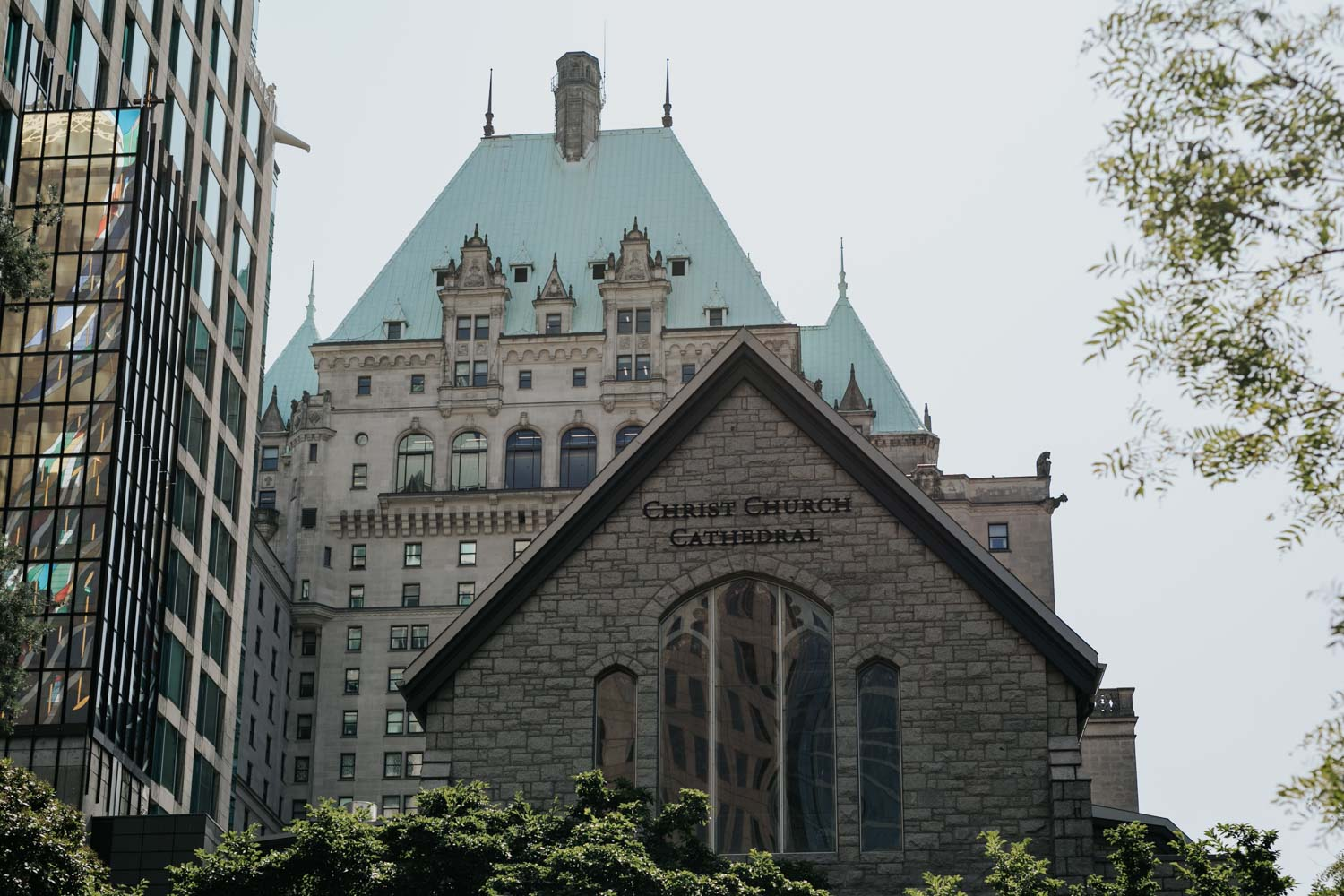 Exterior of Church Church Cathedral in Vancouver with Fairmont the background
