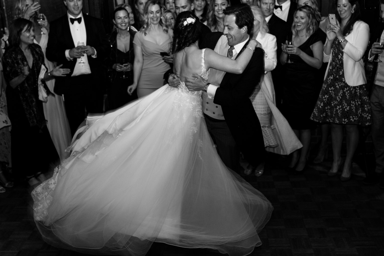 Groom spinning bride during first dance at Brock House Vancouver Wedding Venue