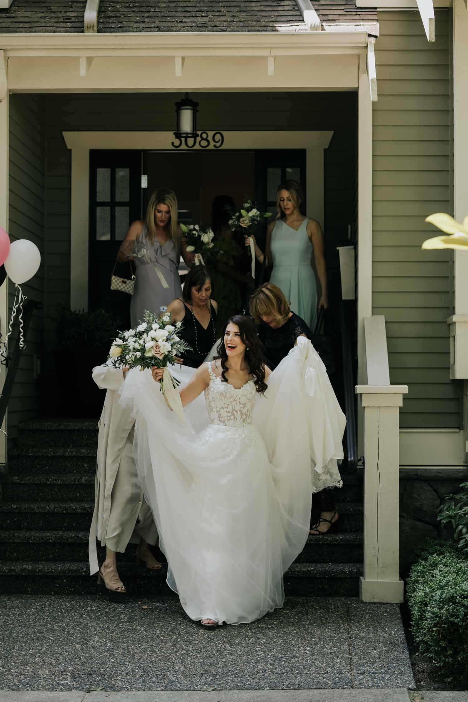 Gorgeous brunette bride wearing vintage modern lace dress leaves her home with her bride tribe to get married at Christ Church Cathedral in downtown Vancouver