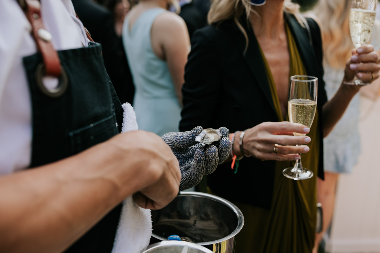 Shucking oysters is a great an alternative ideas for canapes during wedding cocktail hour