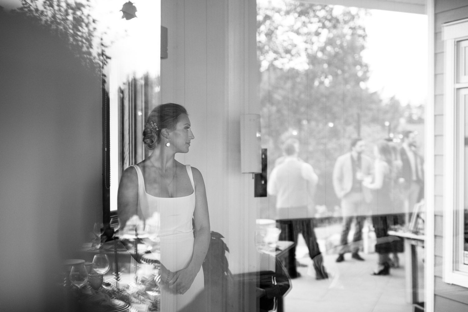 Reflection of bride in the window artistic wedding photo