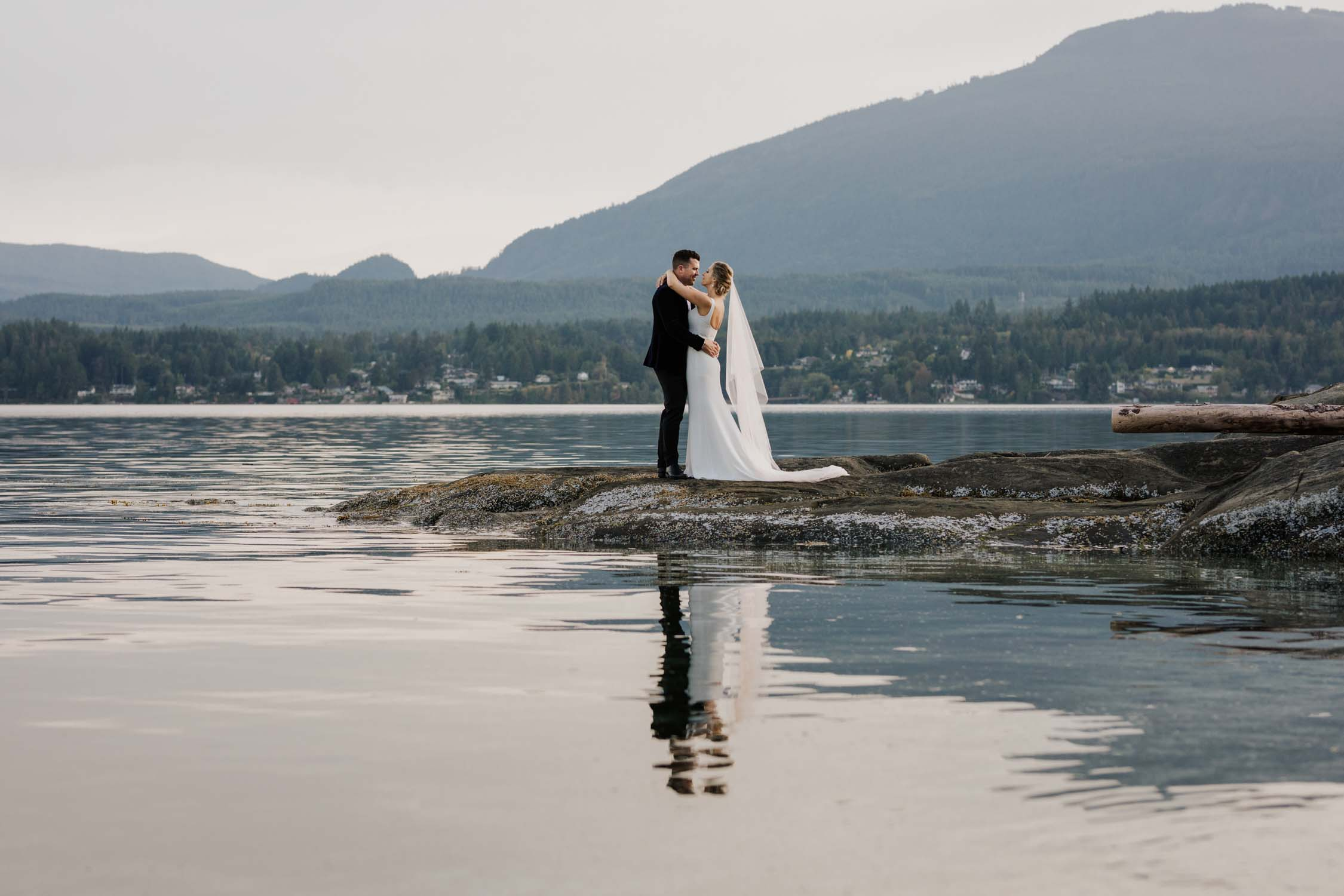 Vancouver Island Wedding Photographer captures intimate beach wedding on Vancouver Island at beautiful venue and location with sea and mountain views
